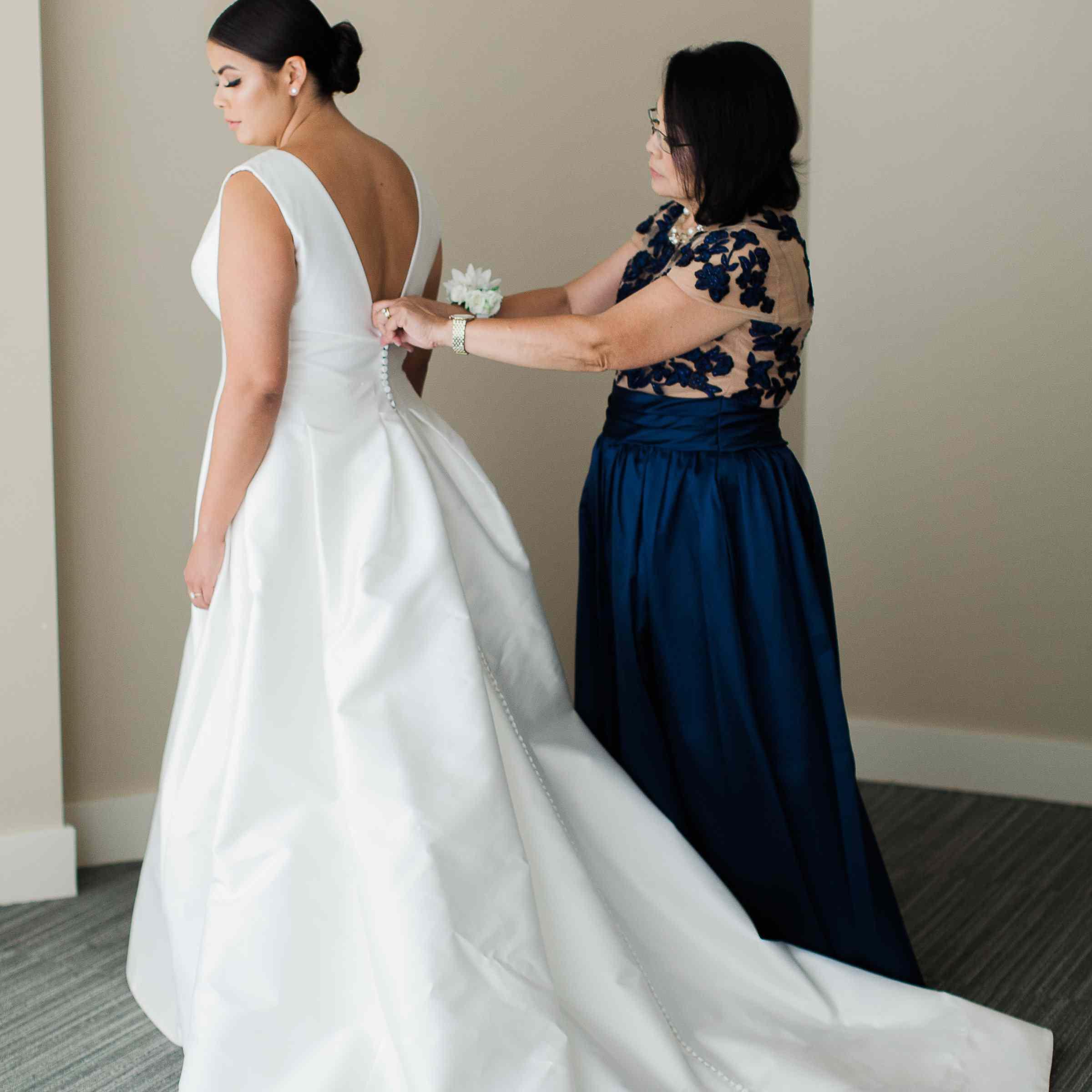 mother of bride zipping wedding dress