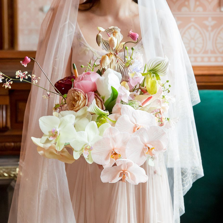 Bridal bouquet featuring orchids and peonies