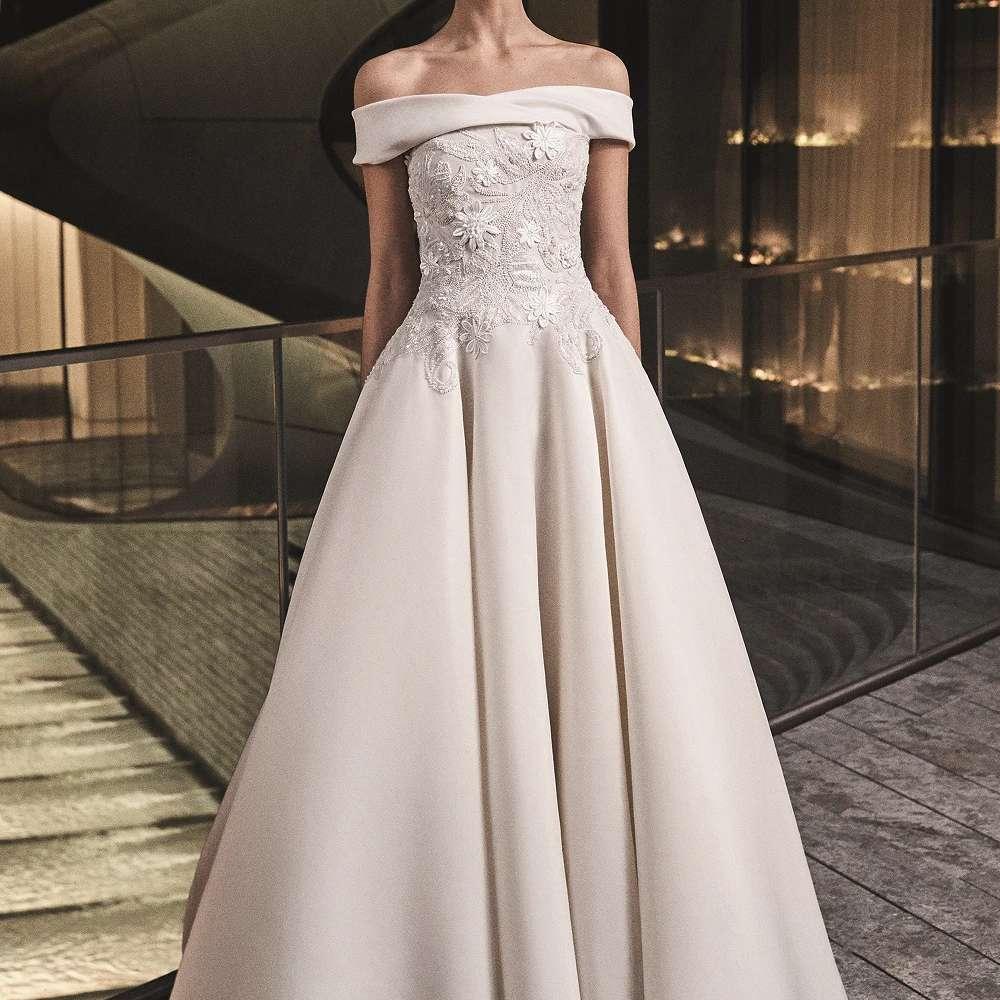 Model in off-the-shoulder ballgown wedding dress
