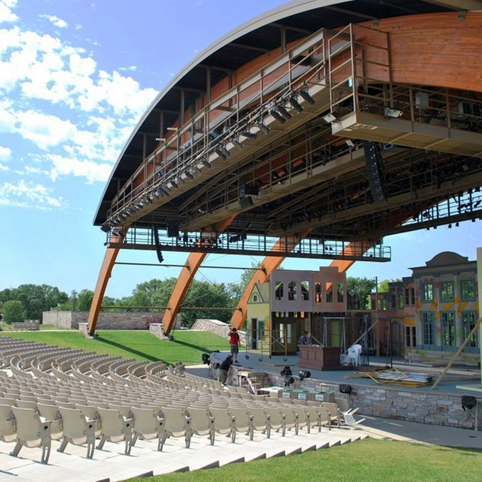 """Fargo may have earned a particular reputation on the big screen, but it's Trollwood Park that may get you to say """"I do."""". The park includes lush grounds, an amphitheater (pictured), gazebo, and barn stage, all perfect for hosting your event. Be warned of ethereal wedding crashers: The park is known to have spirits who call out your name and follow close behind you. Your wedding may attract the most spotted ghost — a woman in dark blue 19th century clothing — who is seen most often when music is played in the park. Find her by her favorite willow tree during your bridal portraits"""