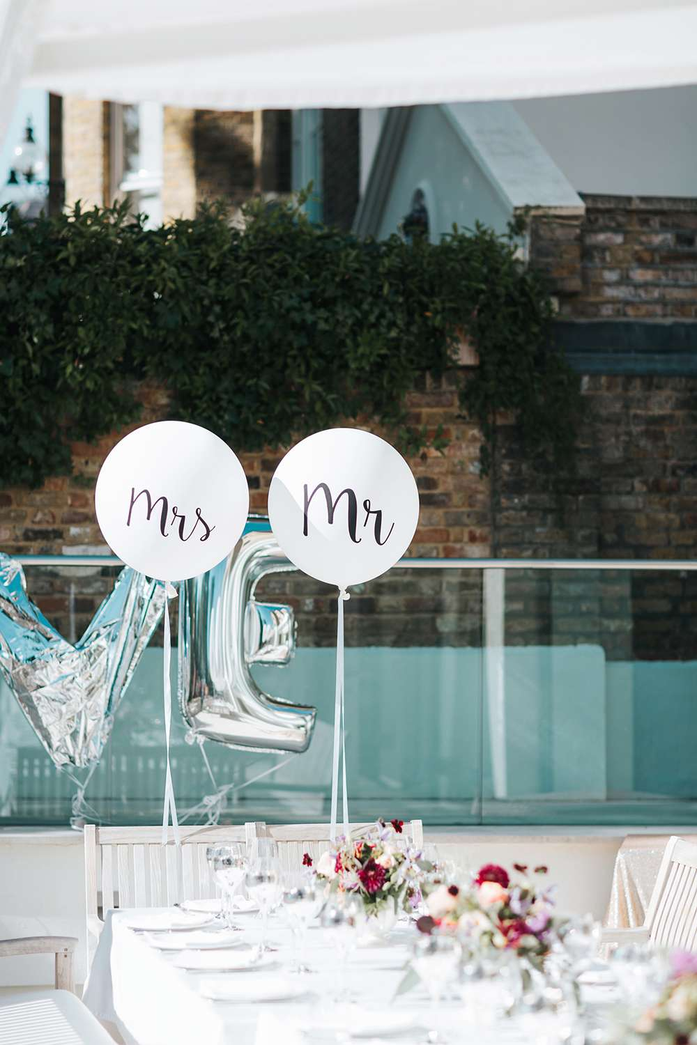 Calligraphy Mr. and Mrs. balloons.