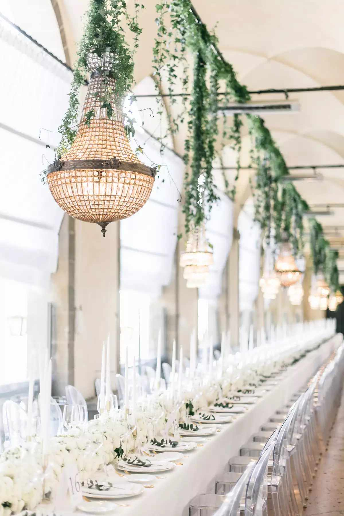 neutral chandelier with greenery