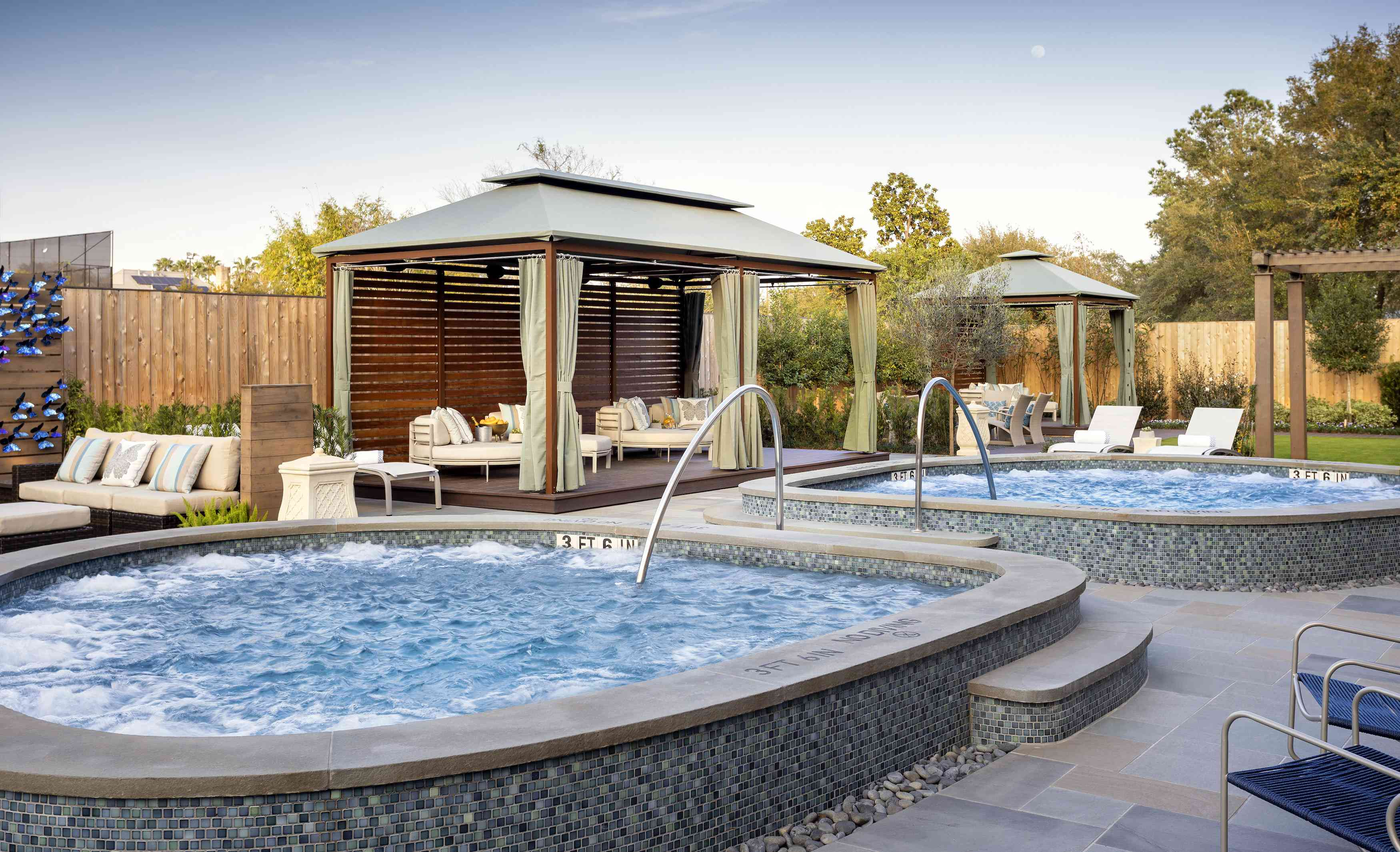Private cabanas and heated pools at Trellis Spa