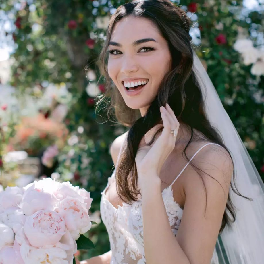 Bride smiling in half up half down hairstyle
