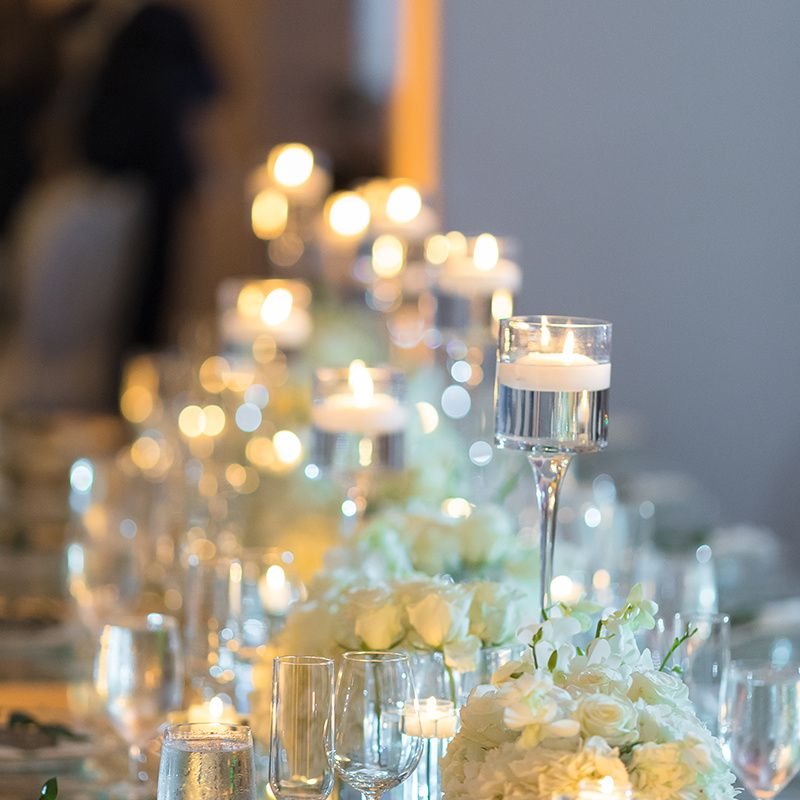 A table adorned with various candles.