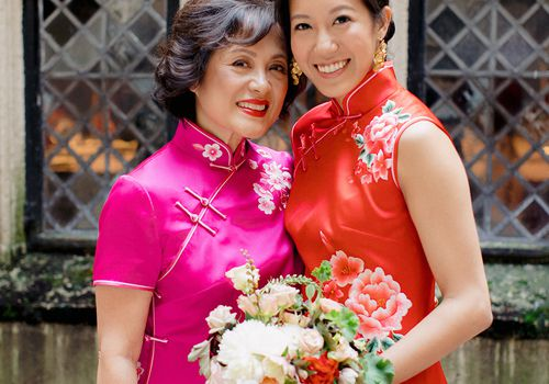 mother of the bride and bride holding bouquet