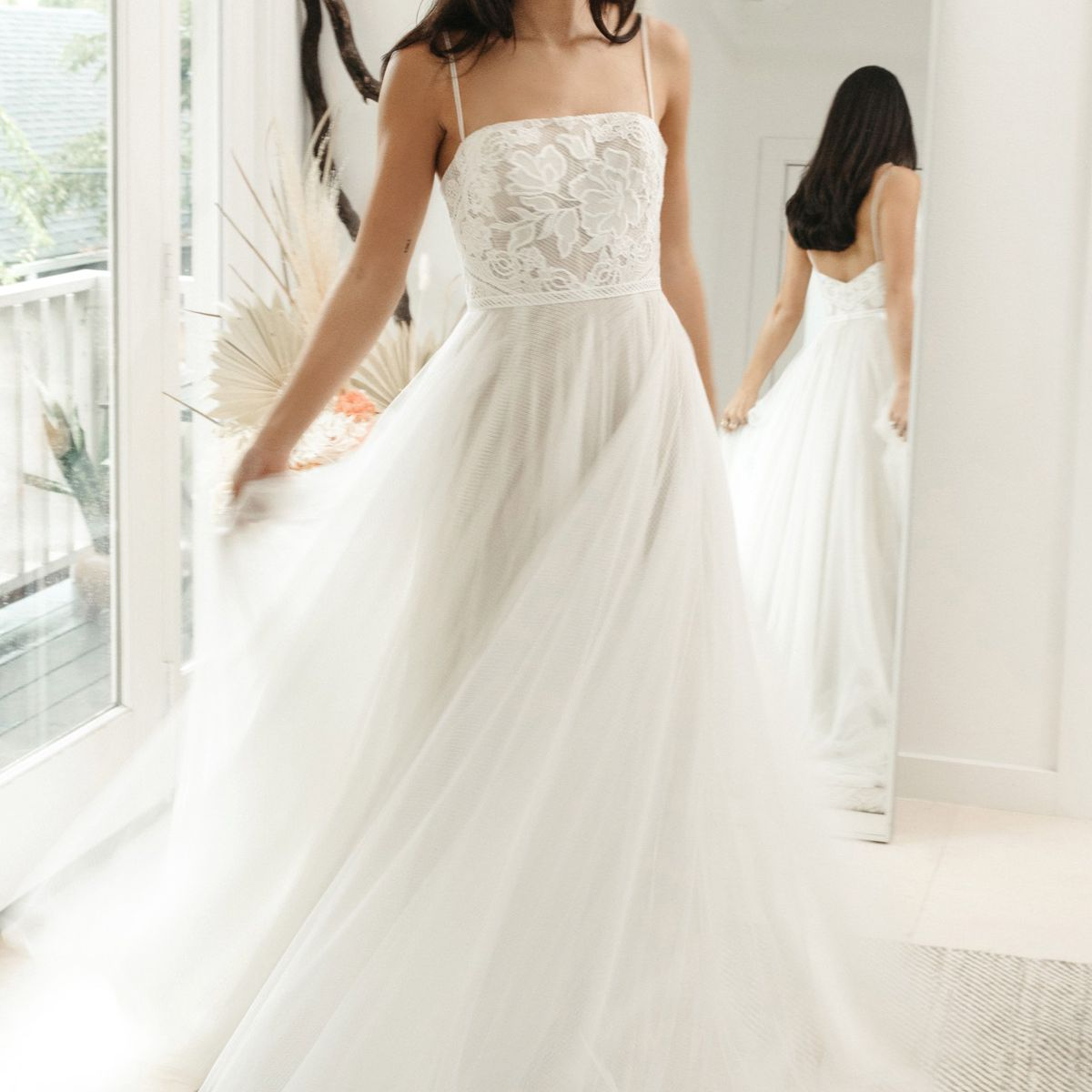 Model in a strapless A-line gown with a lace bodice and tulle skirt