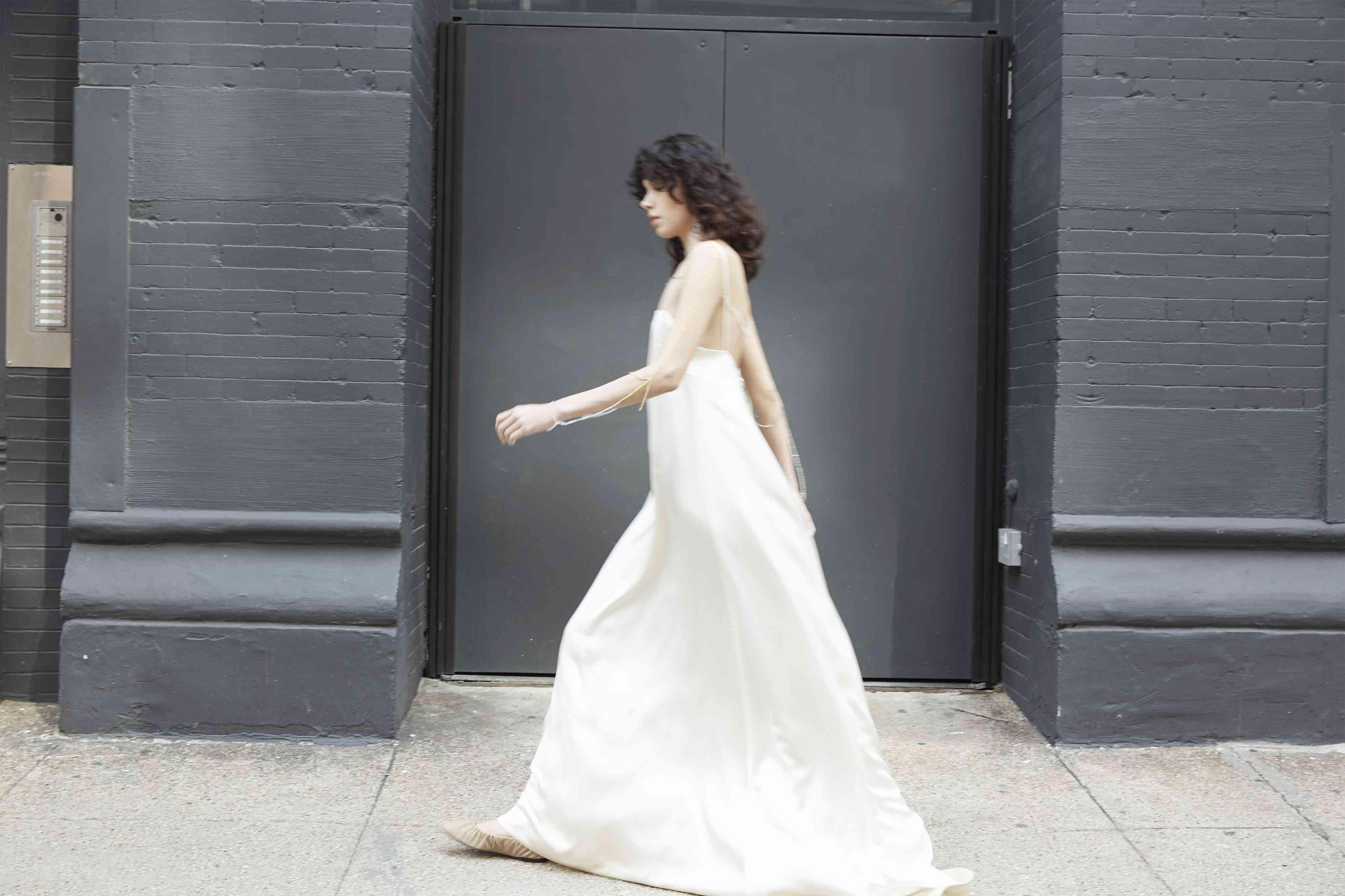 Model in slip wedding dress