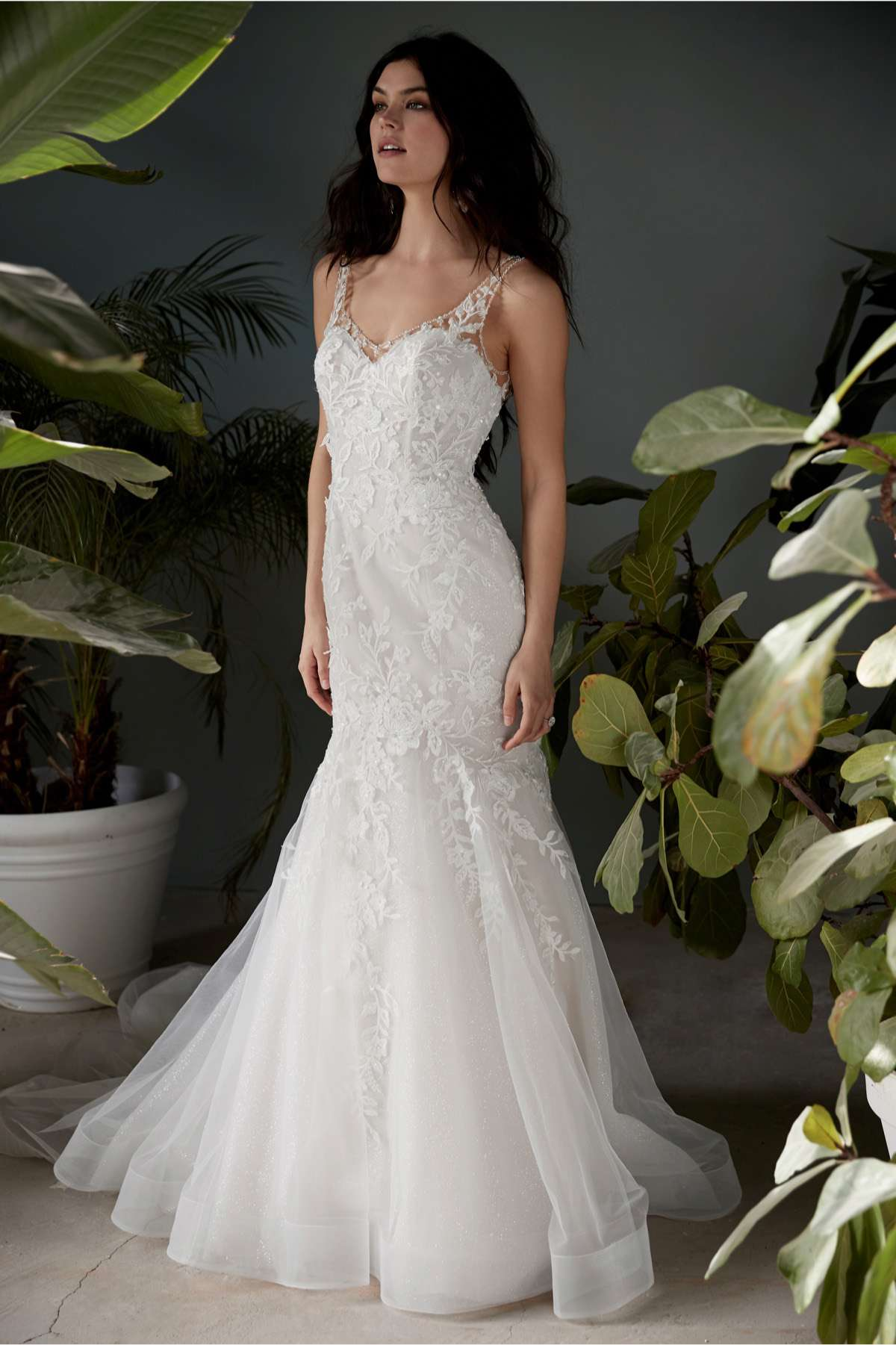 Model in beaded lace V-neck fit-and-flare gown with tulle skirt