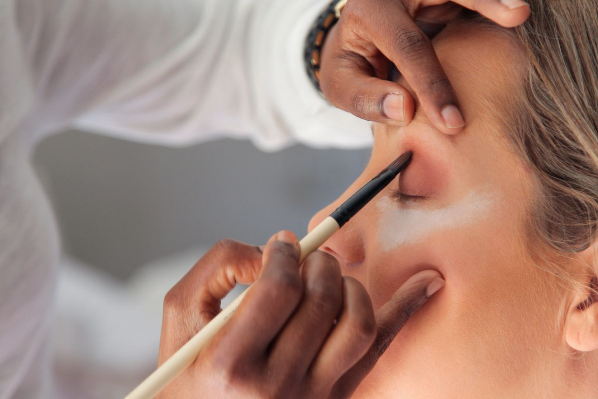 woman getting makeup done