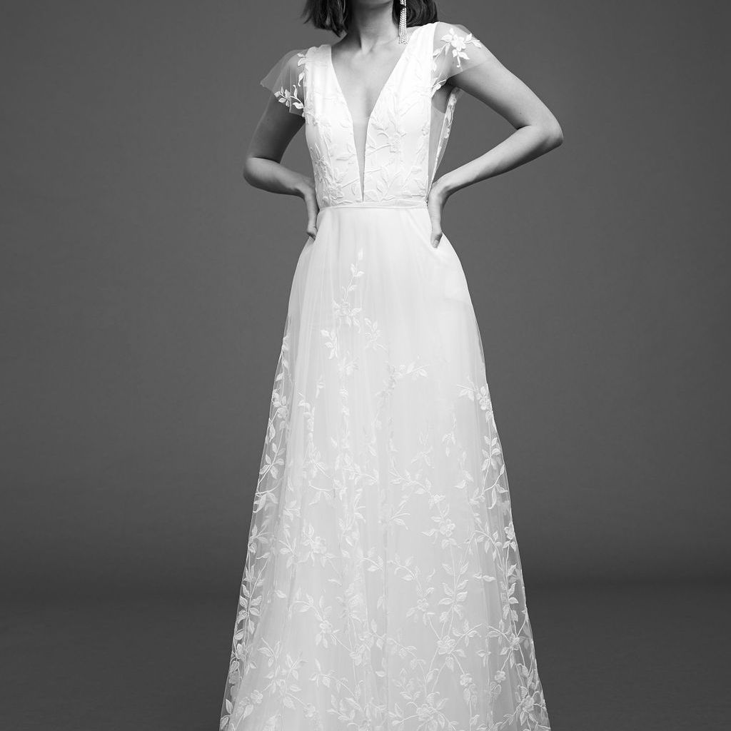Model in A-line gown with embroidered tulle and cap sleeves
