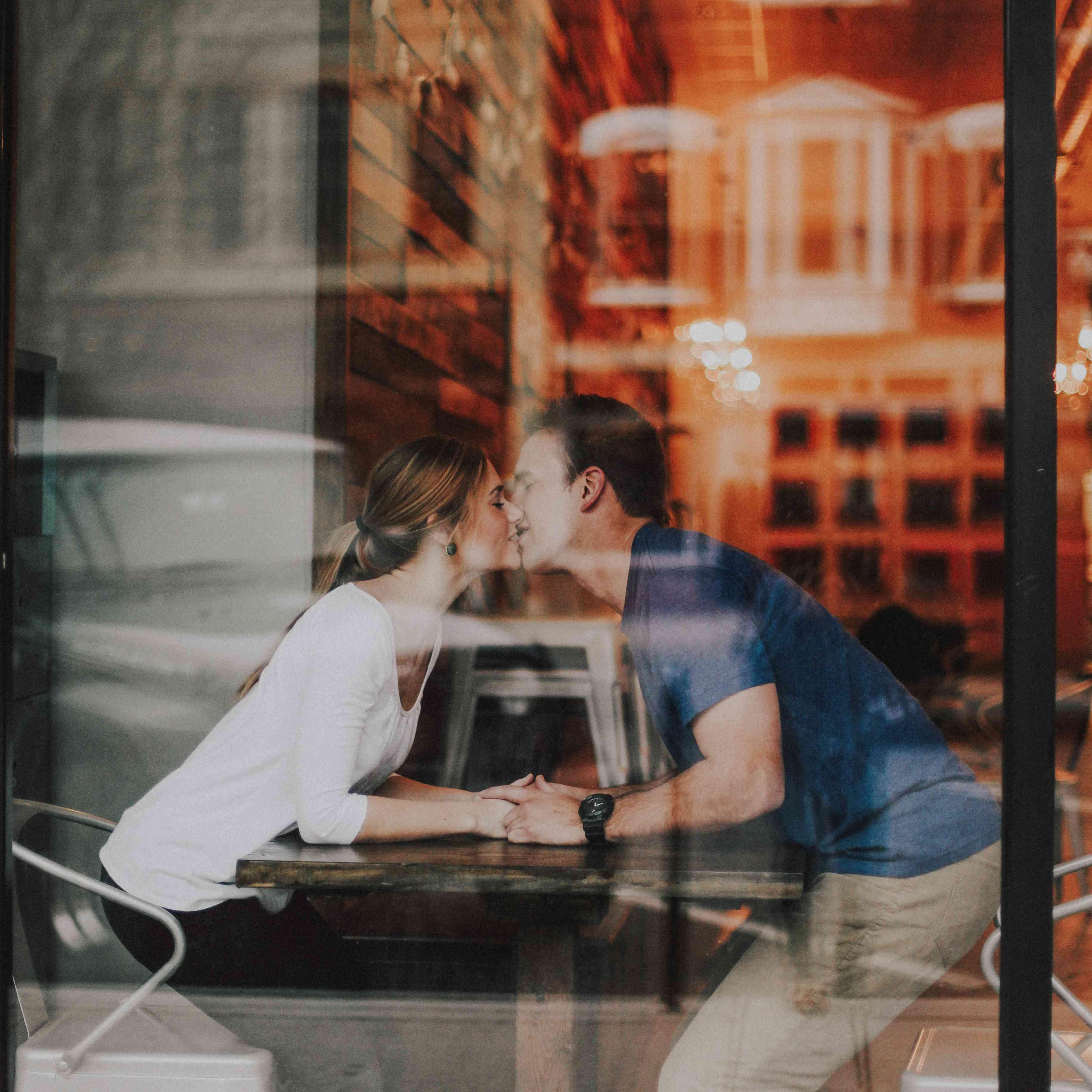 Couple kissing inside window