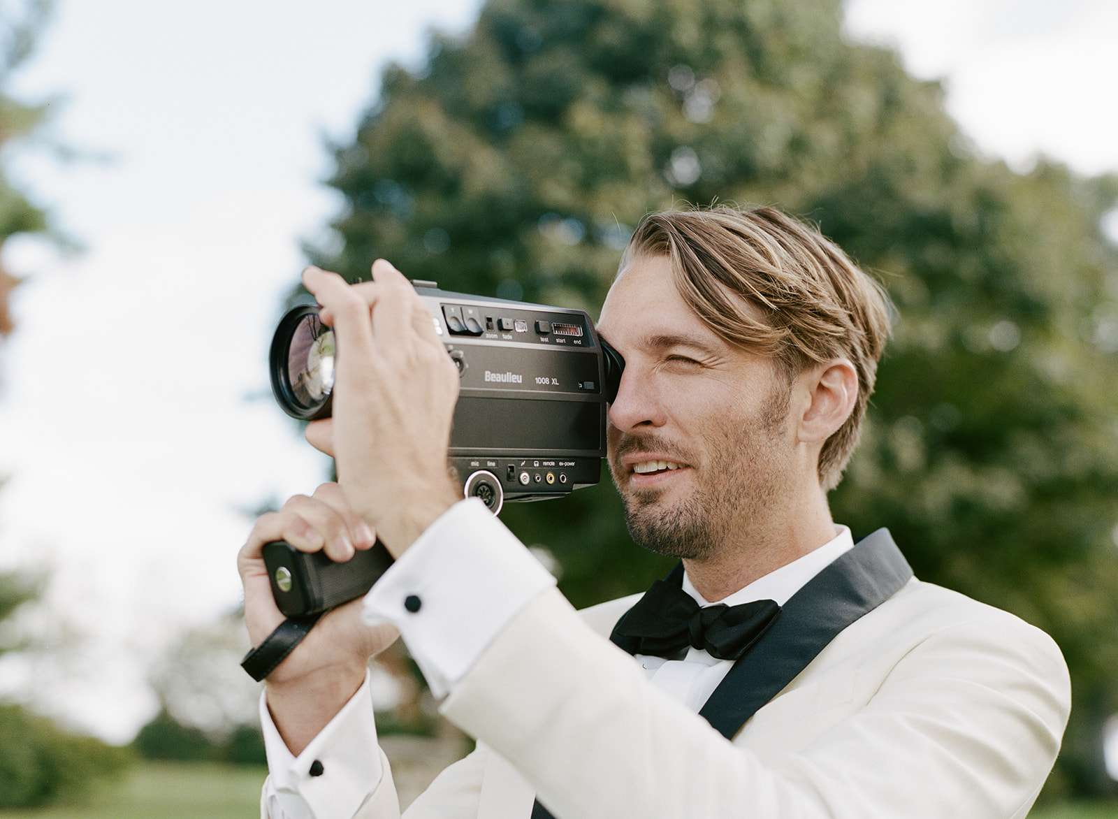 The groom with a Super 8 camera