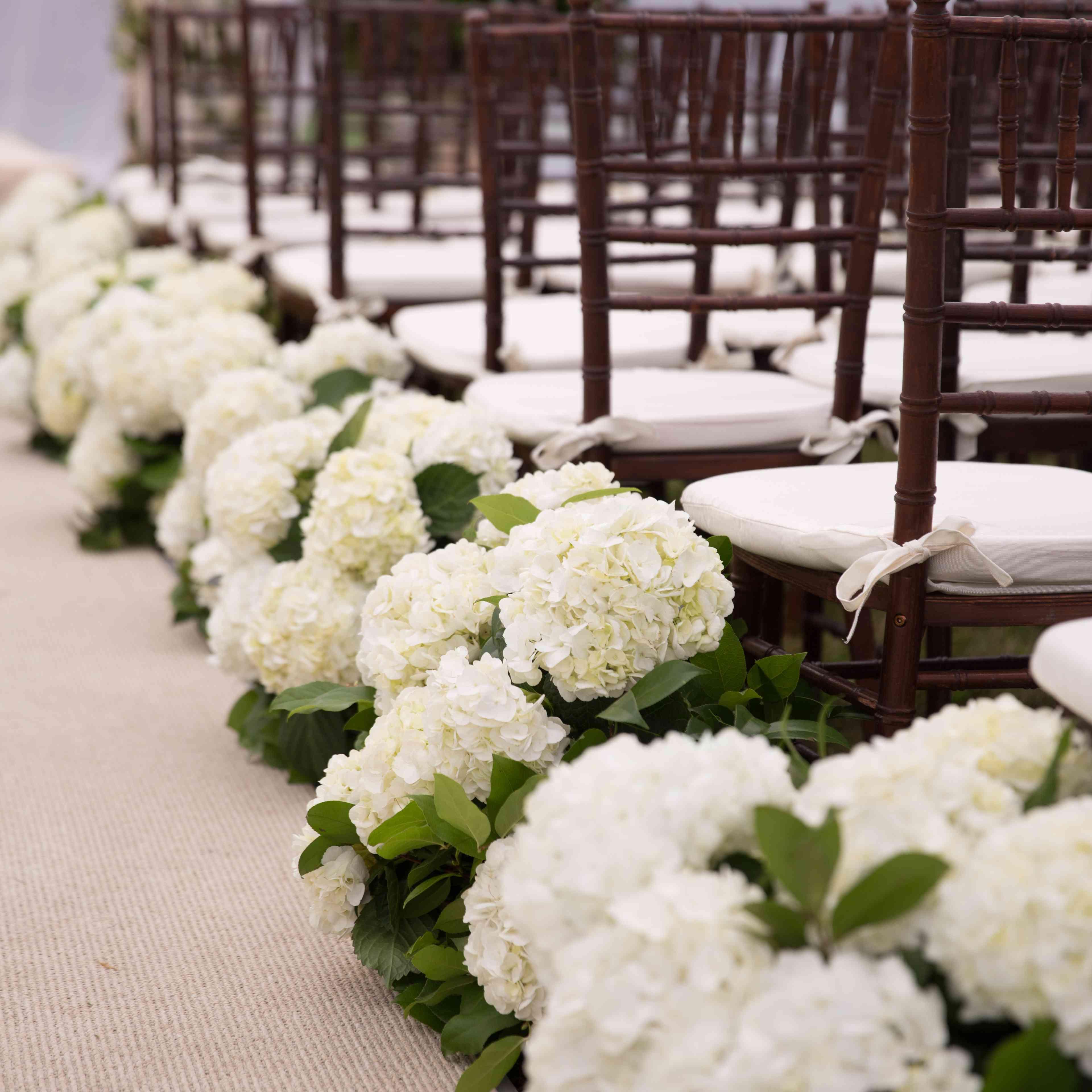 Wedding aisle floral arrangement