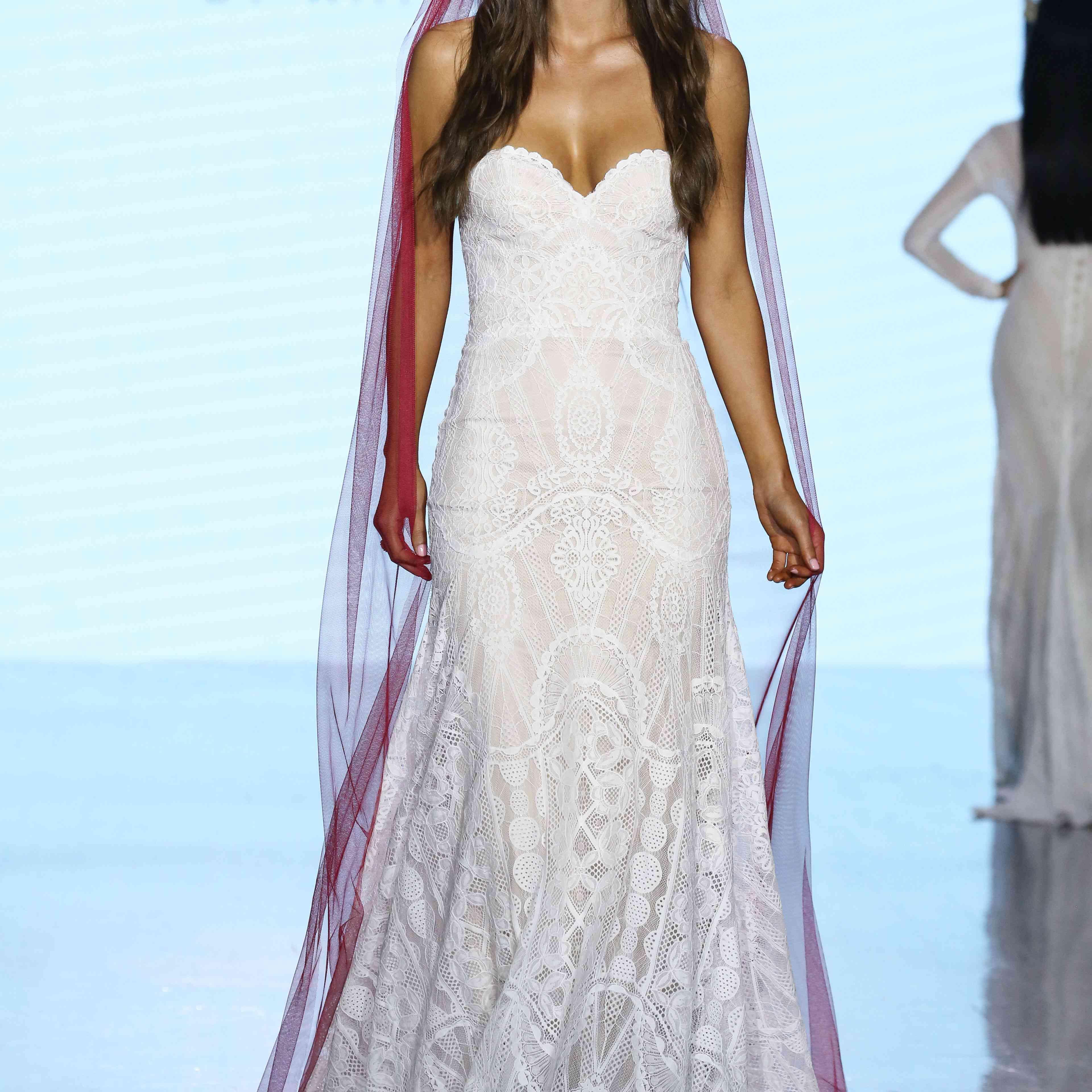 Model in strapless geometric lace wedding dress
