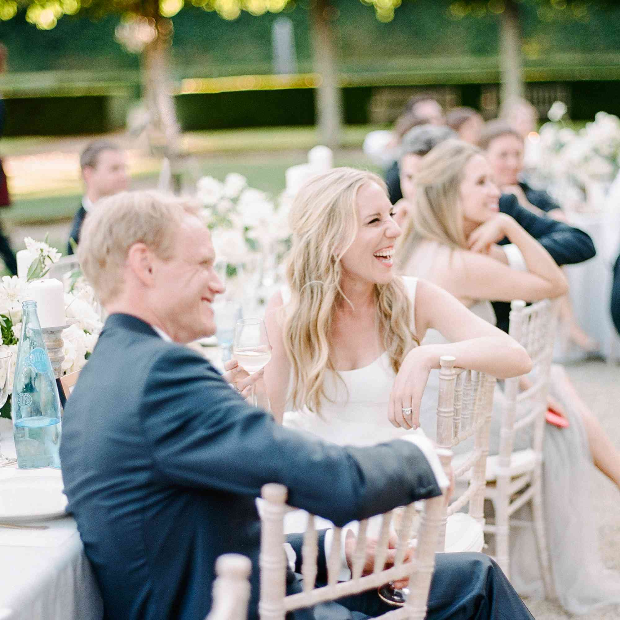<p>Bride and groom laughing at reception</p><br><br>
