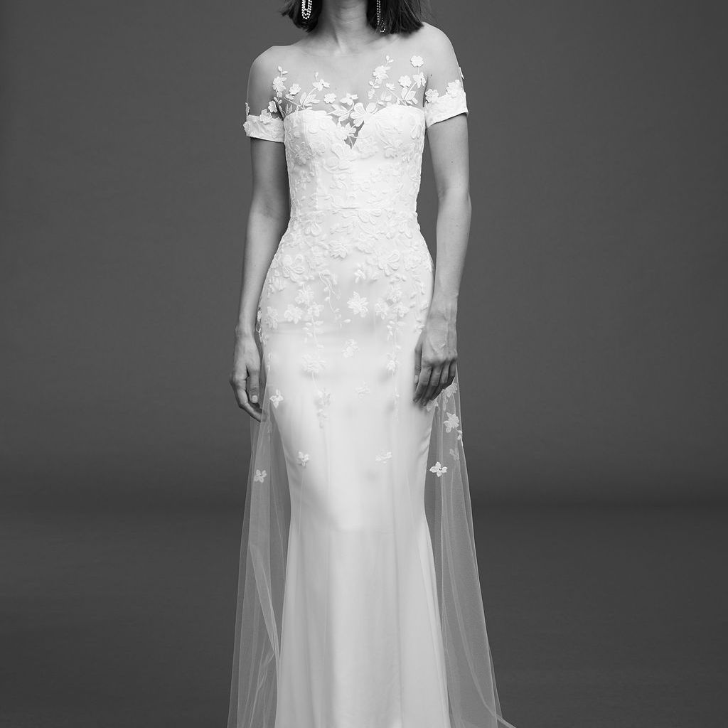 Model in short-sleeve dress with illusion neckline and a floral emroidered tulle overlay
