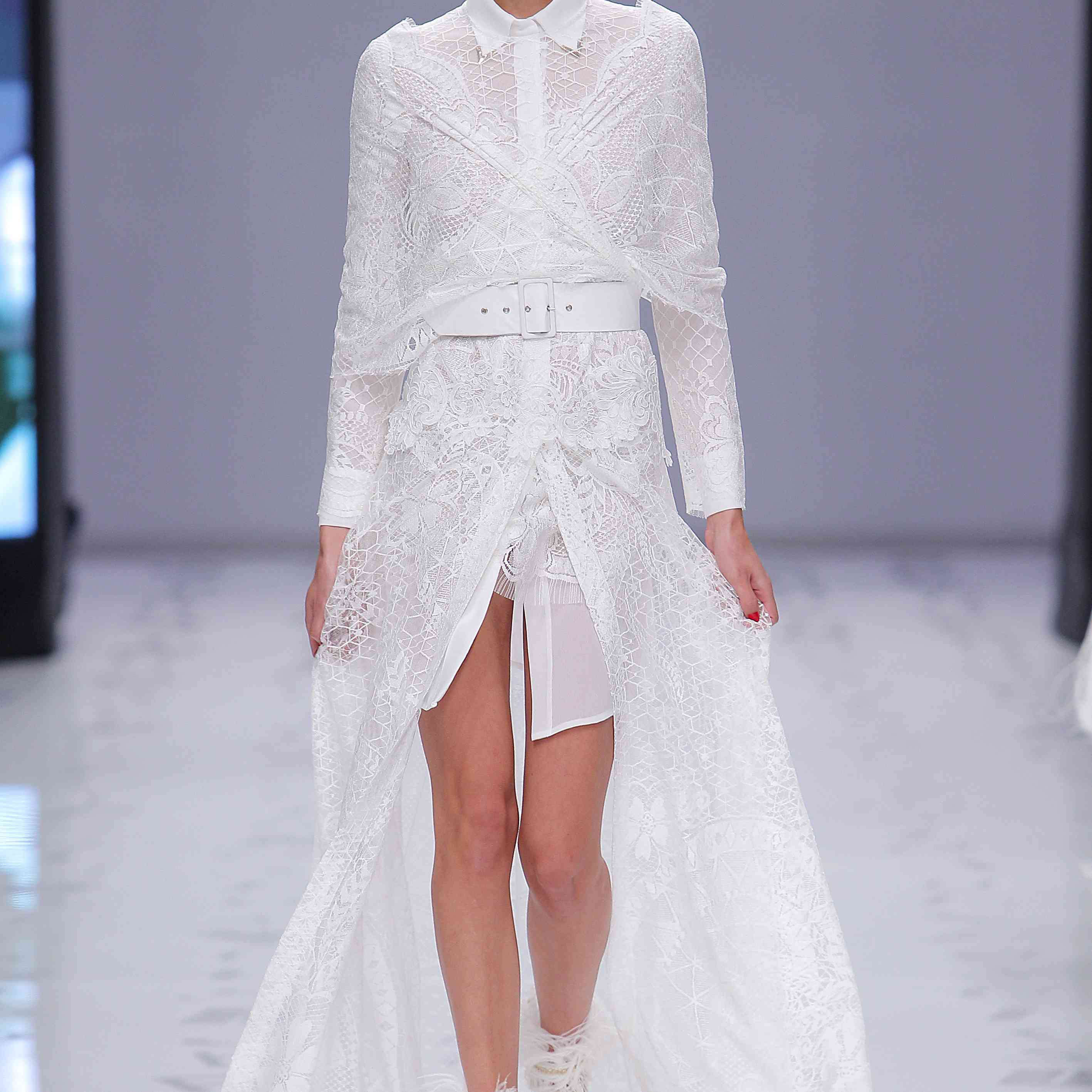 Model in allover lace long-sleeve dress with high center front slit and a collared neckline