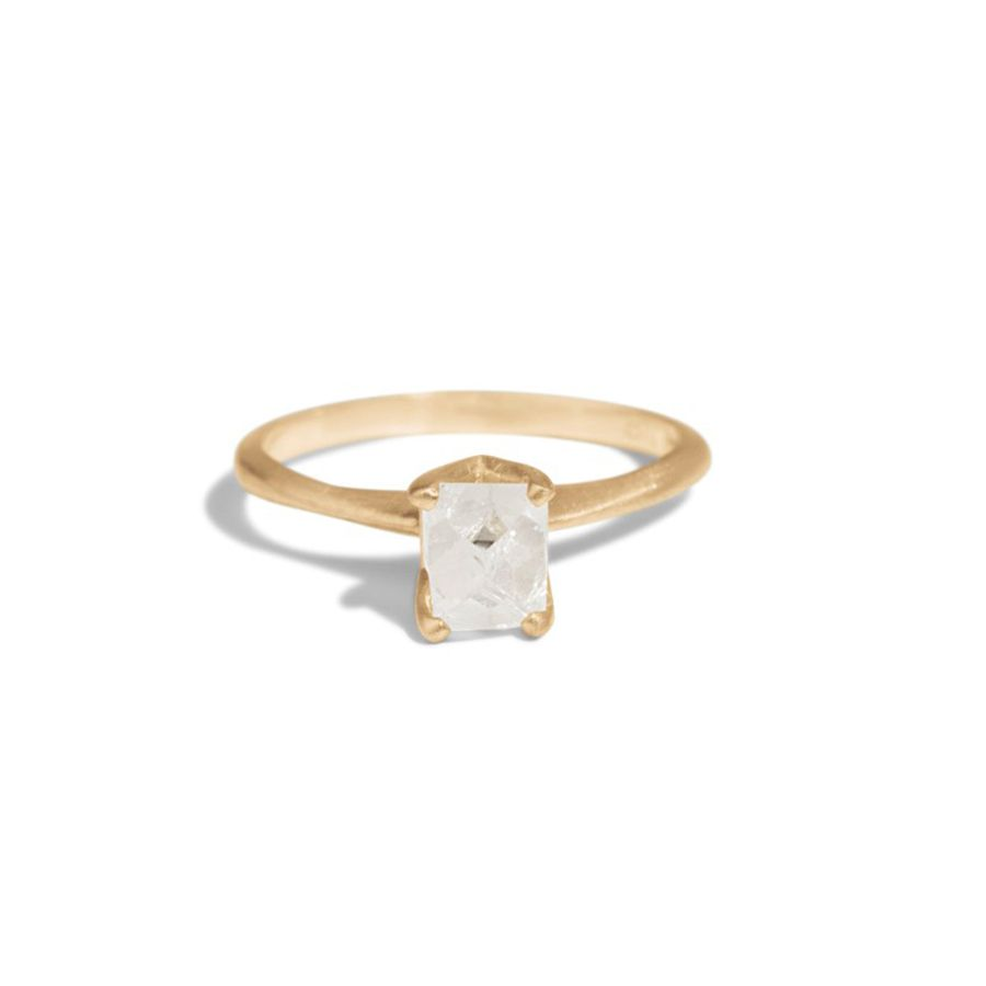 Raw diamond solitaire in matte yellow gold setting