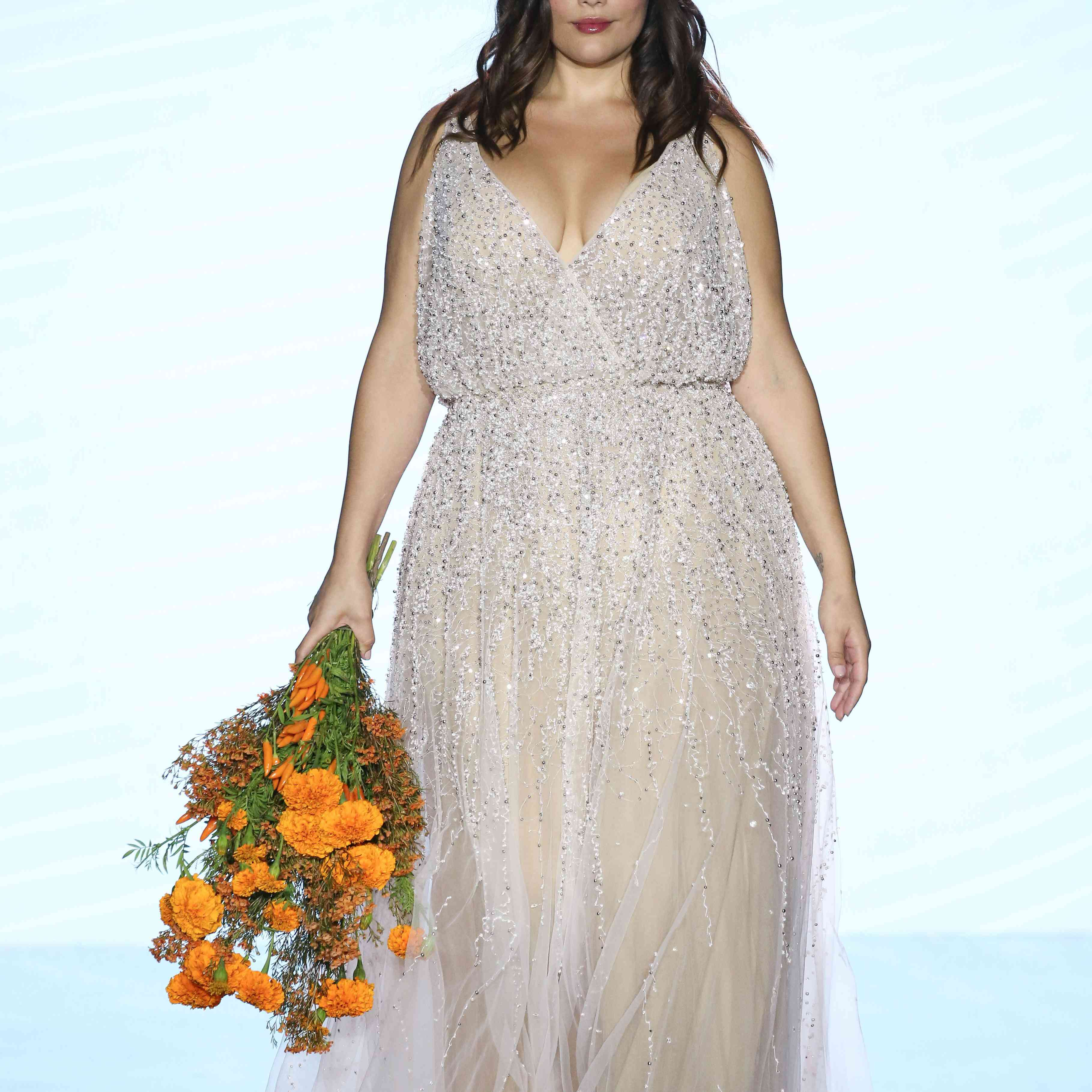 Model in allover sparkle wedding dress with wrapped V-neck bodice