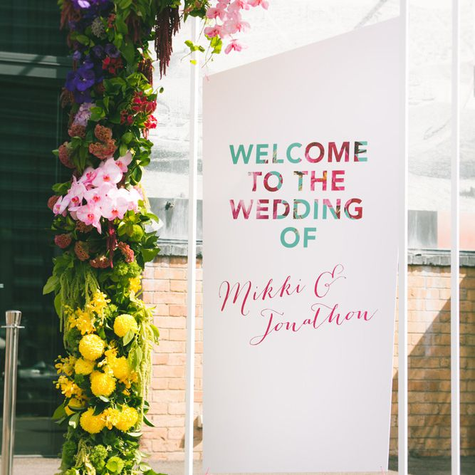Floral accented welcome sign