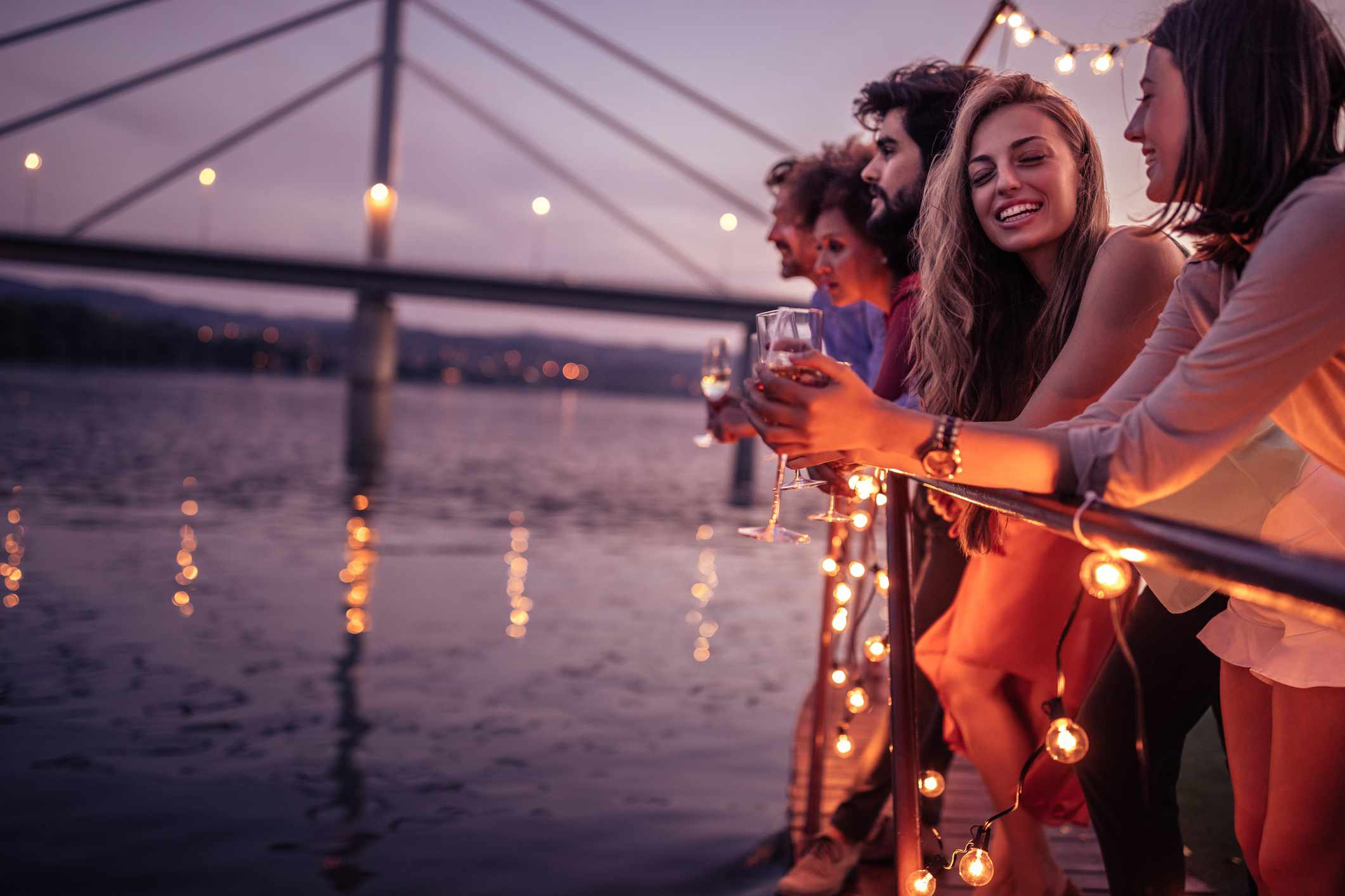 Guests enjoying drinks on boat