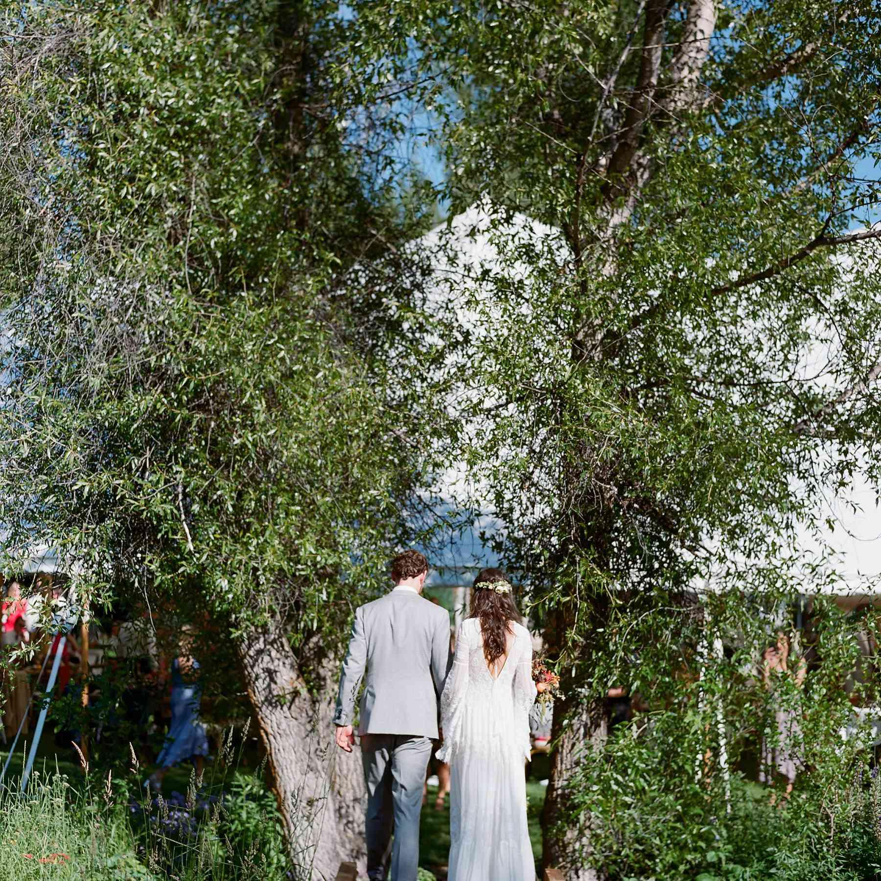 <p>Bride and groom entering reception</p><br><br>
