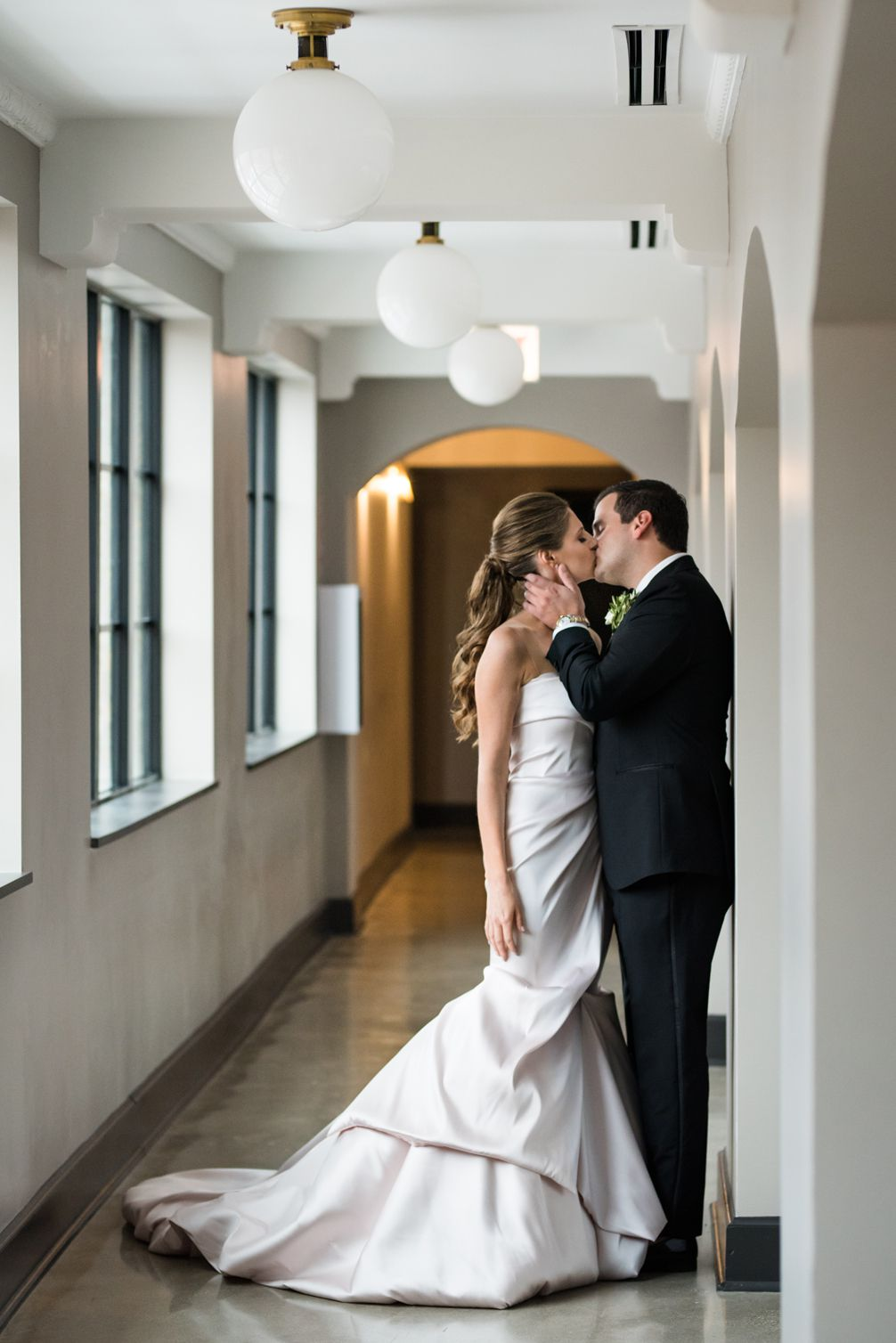 Bride and the groom share a kiss