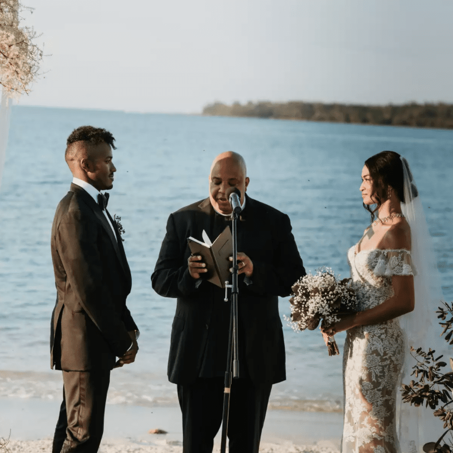 Newlyweds at the altar in front of ocean