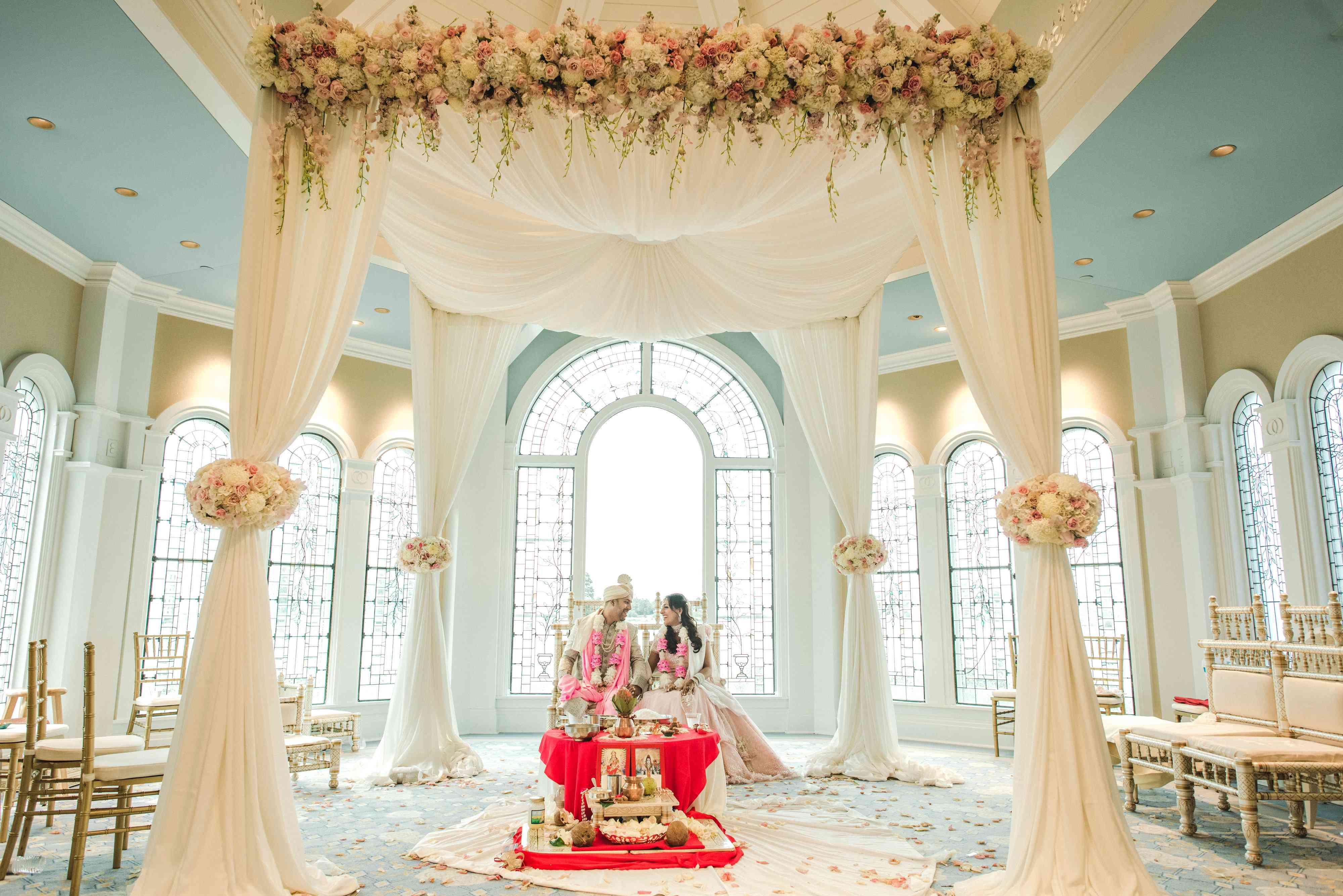 Couple sitting in wedding ceremony room.