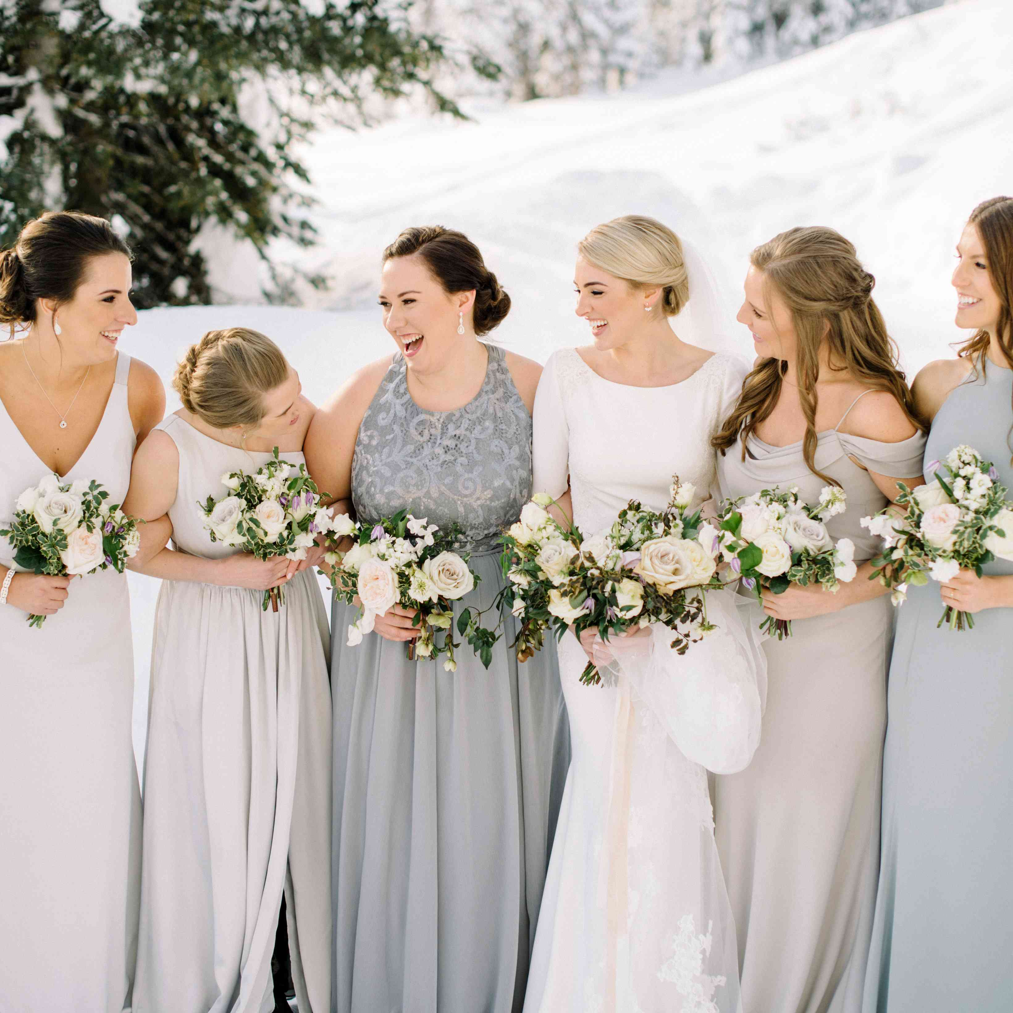 bridesmaids in mismatched grey dresses