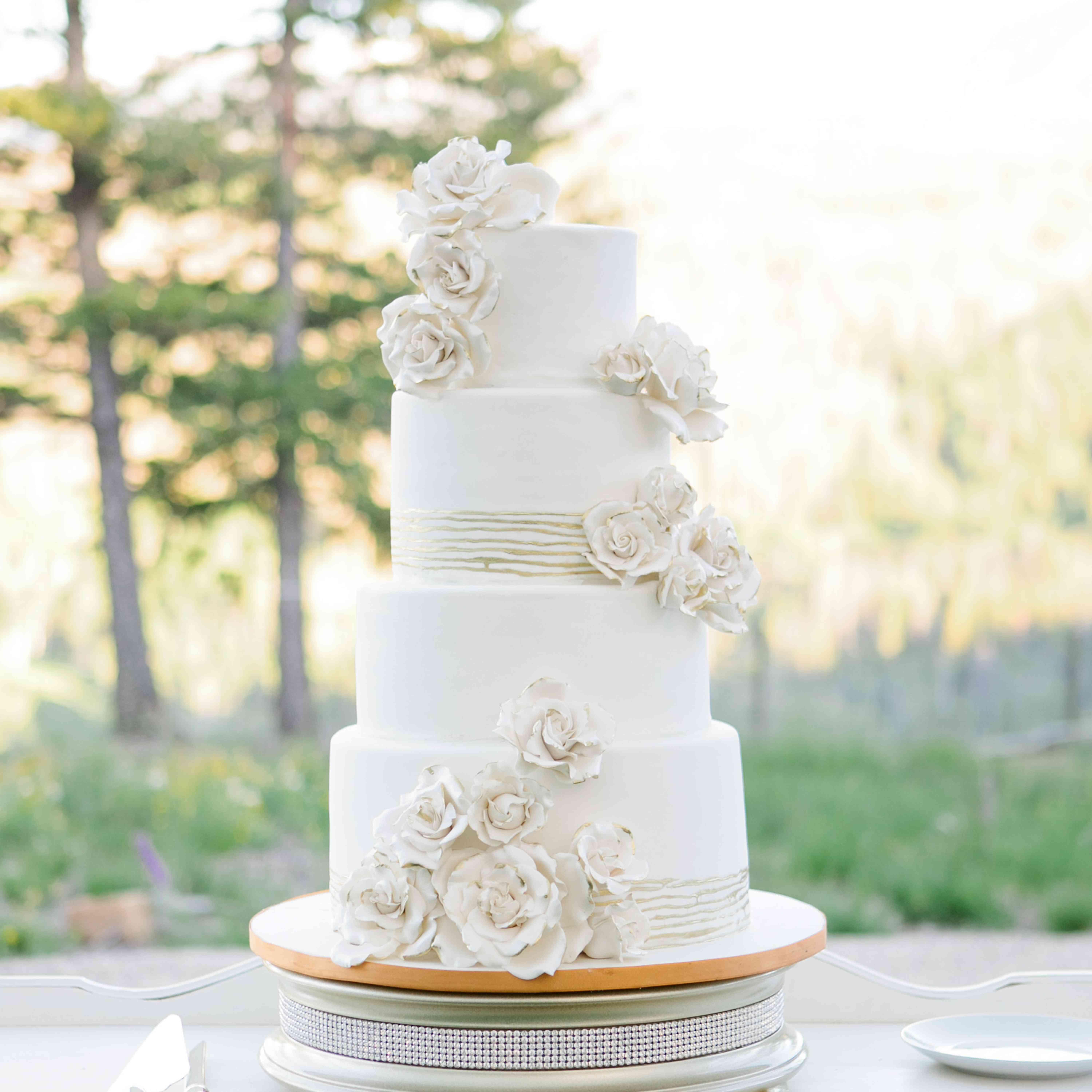 White Four-Tiered Wedding Cake