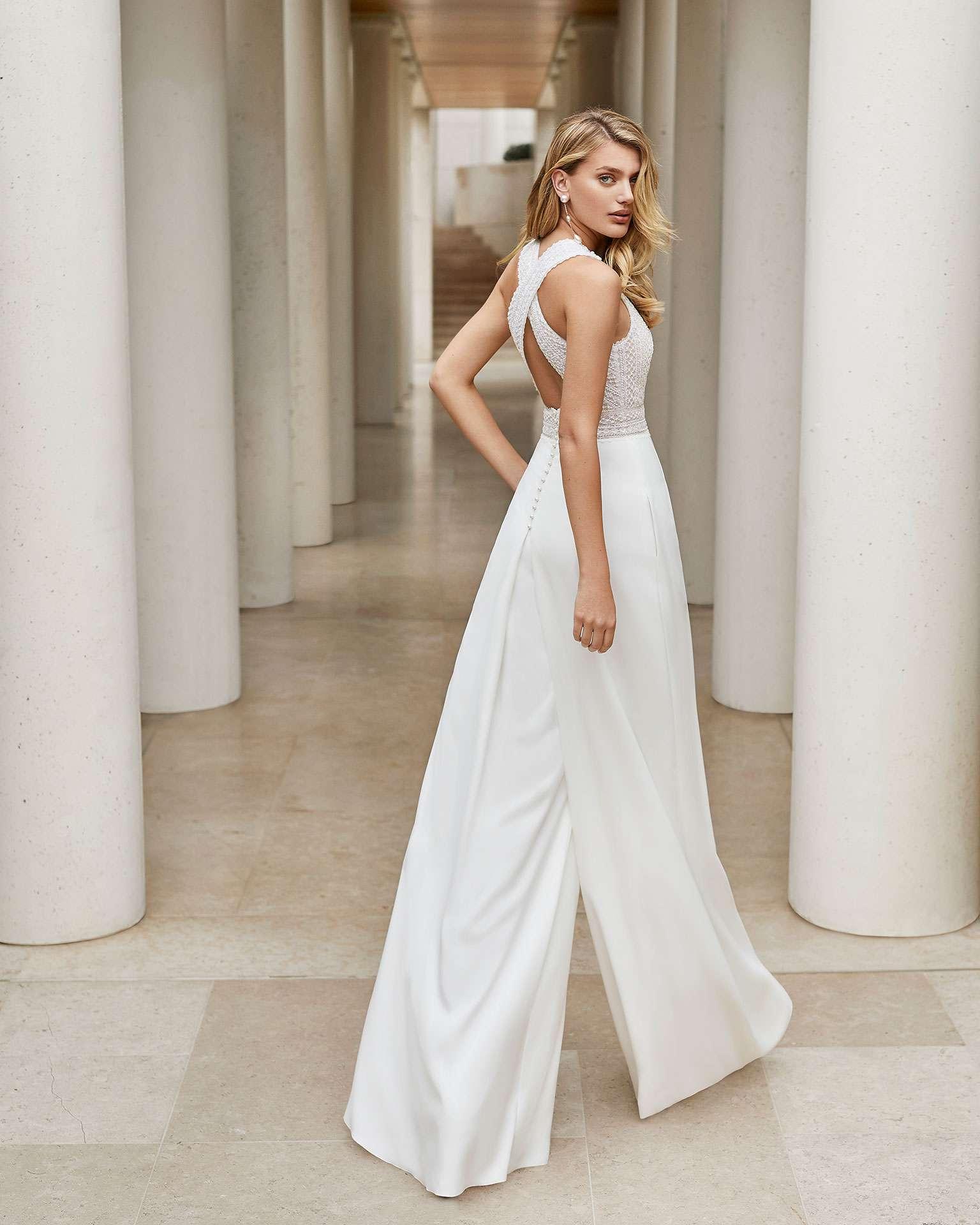 Model in white bridal suit