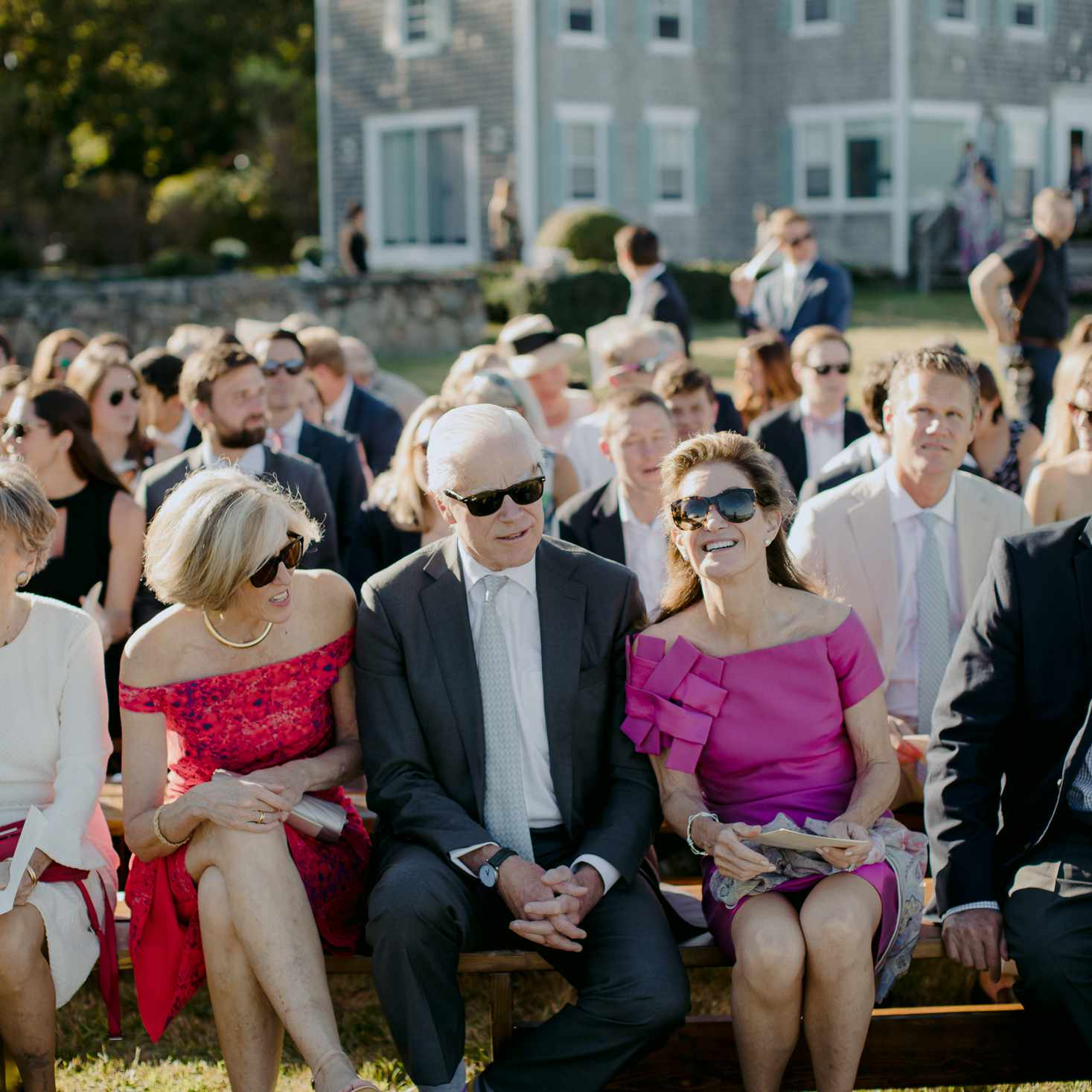 at-home rustic massachusetts wedding, guests sitting outside on benches