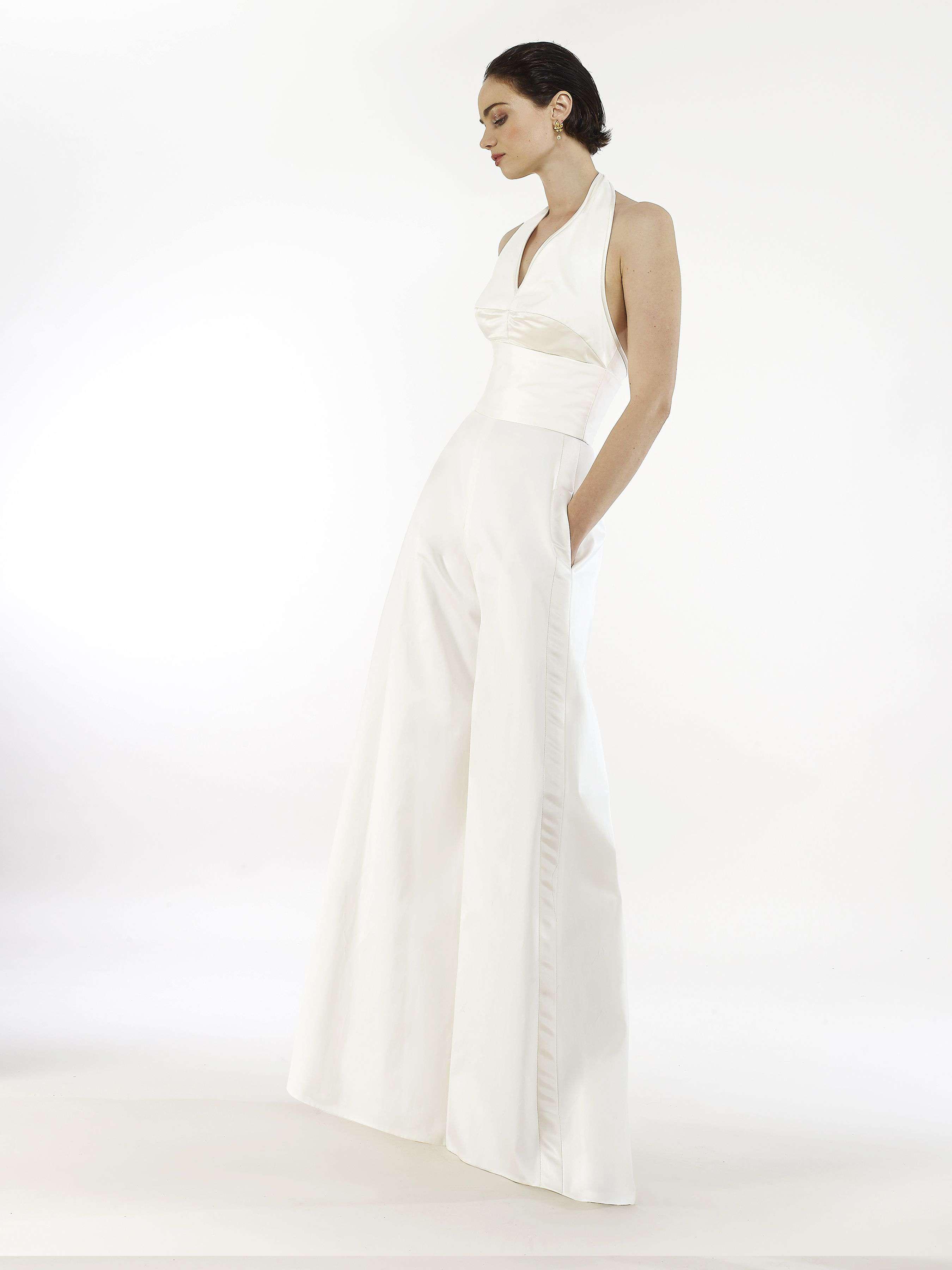 Model in halter-neck bridal jumpsuit with wide-leg pants