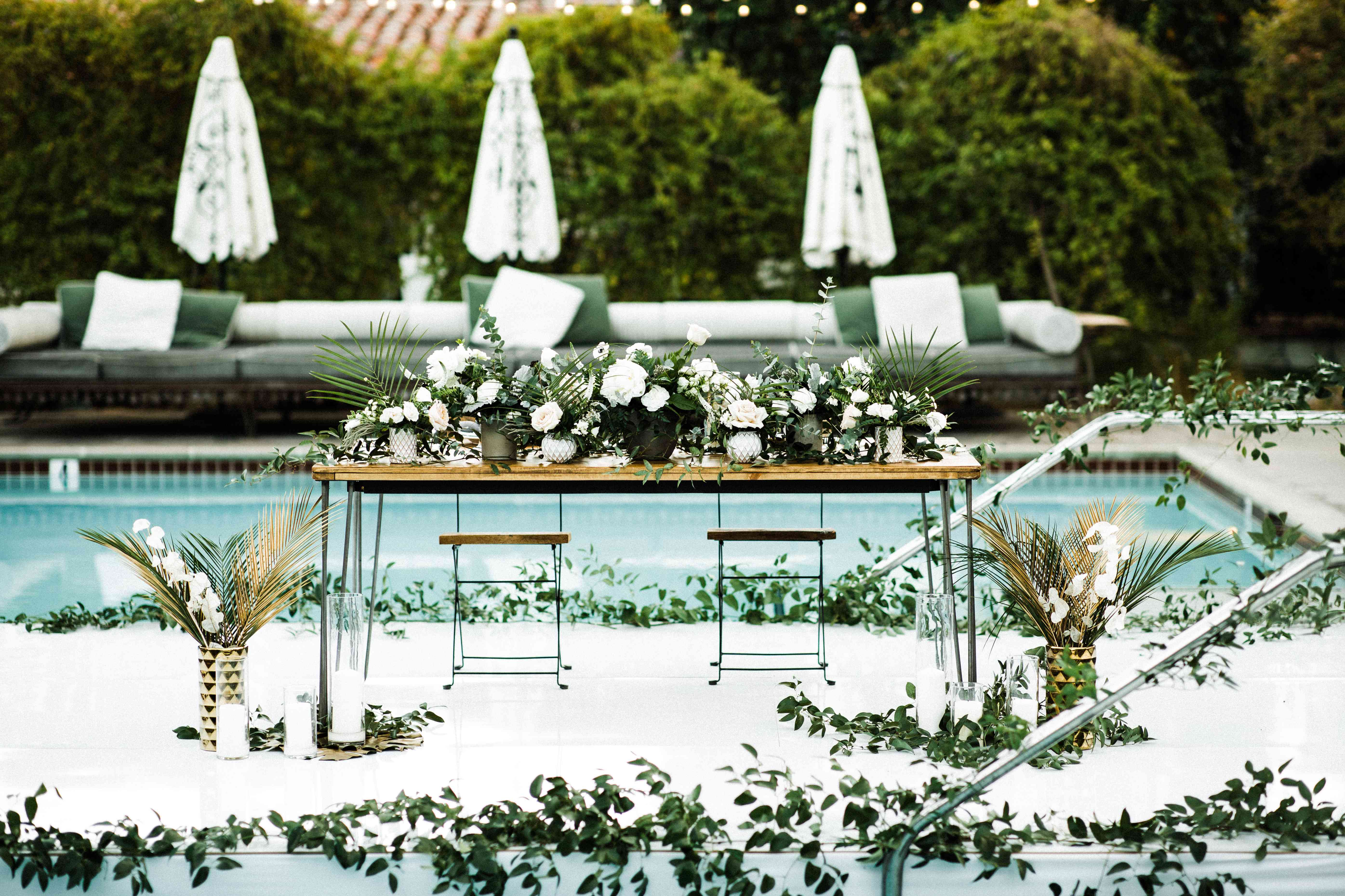 Sweetheart table with palm leaves