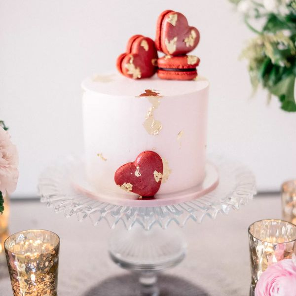 Pink cake with red heart macarons