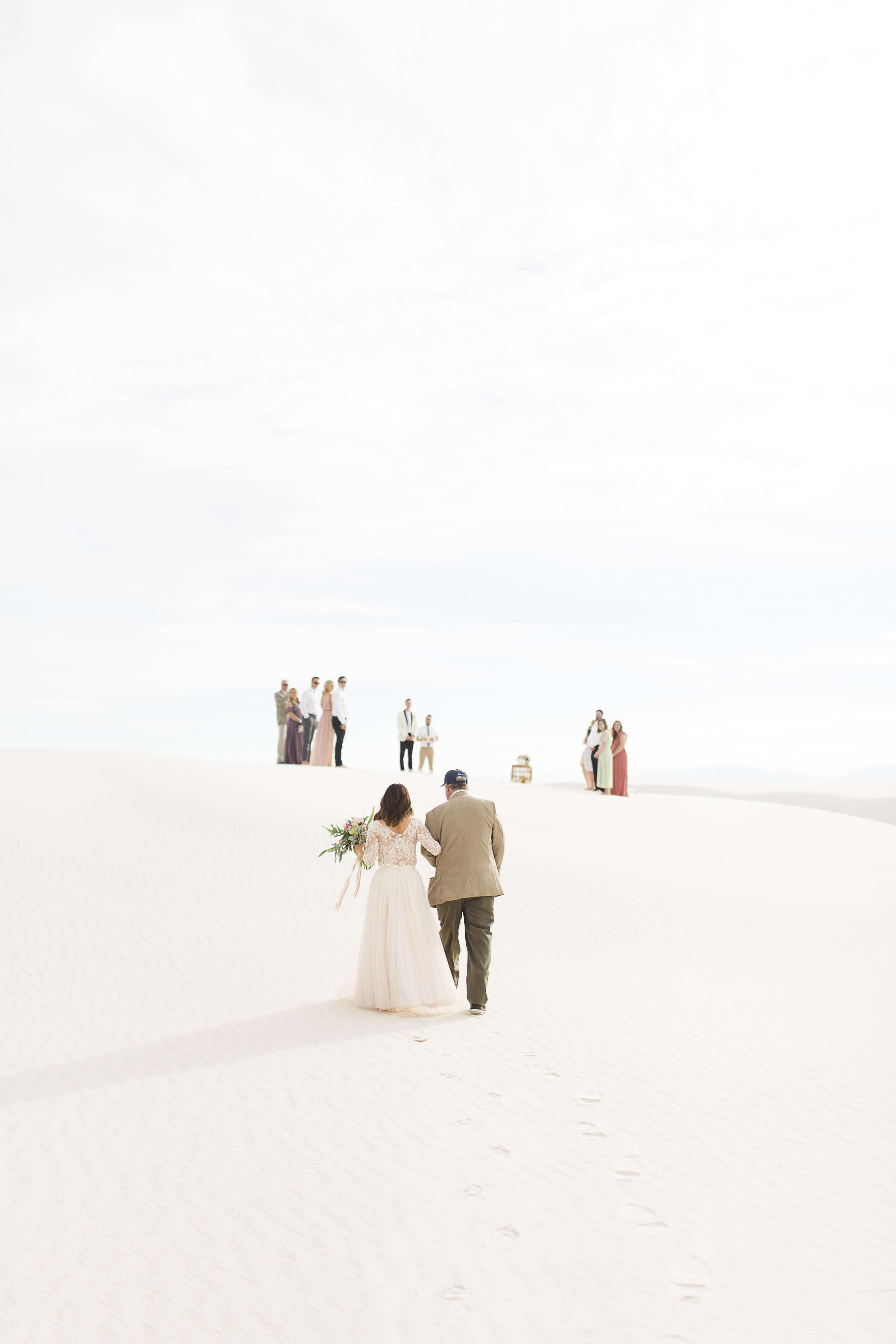Bride Walks Down Aisle in Desert
