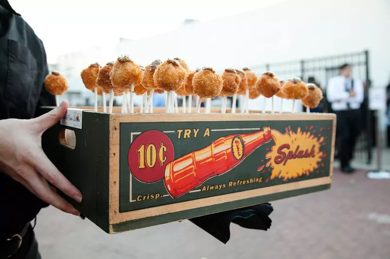 Mac and cheese lollipops in a serving tray