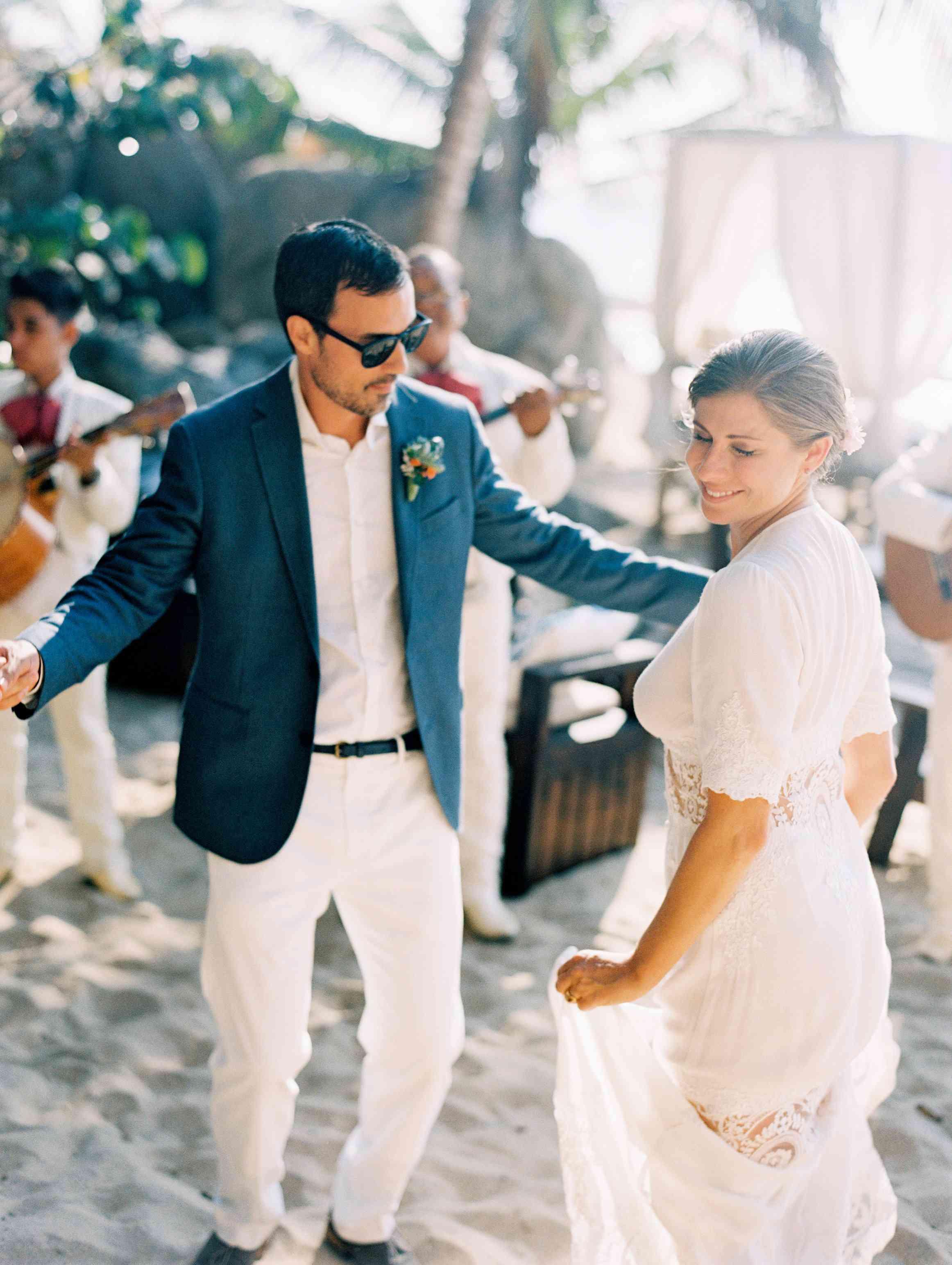 Newlyweds dancing on beach