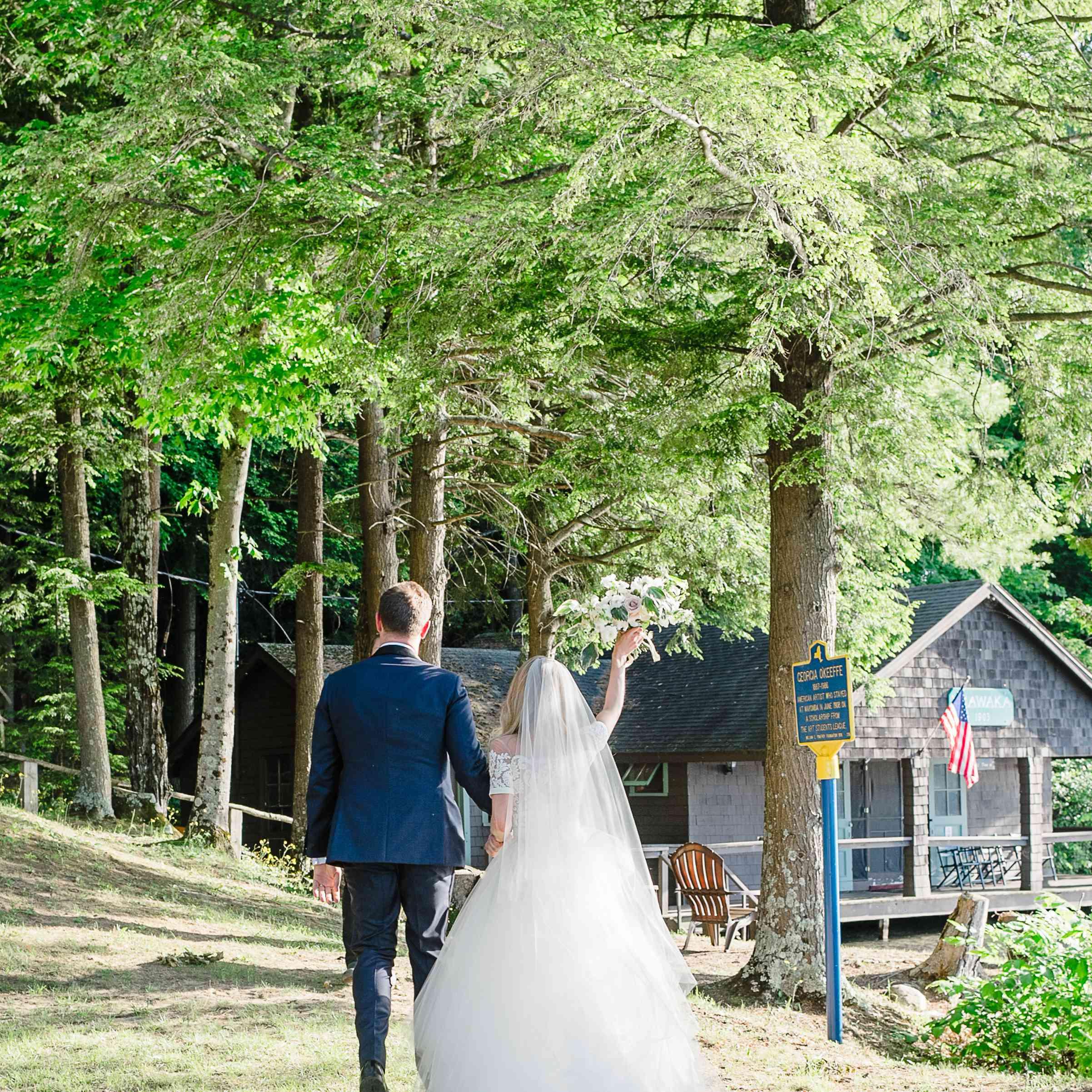 <p>Bride and groom near cabin</p><br><br>