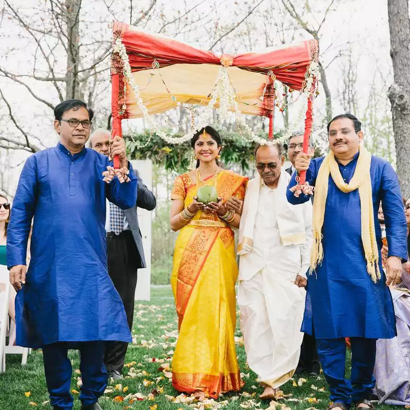 Brides walks with two paternal uncles