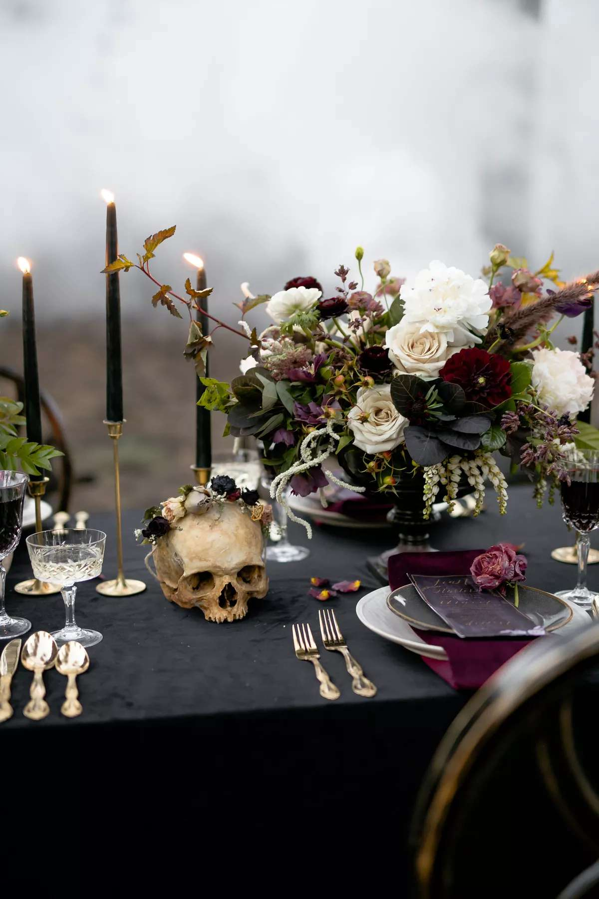 Table decorated with dark colors and a skull