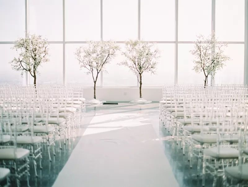 An all-white ceremony space transformed into a winter wonderland