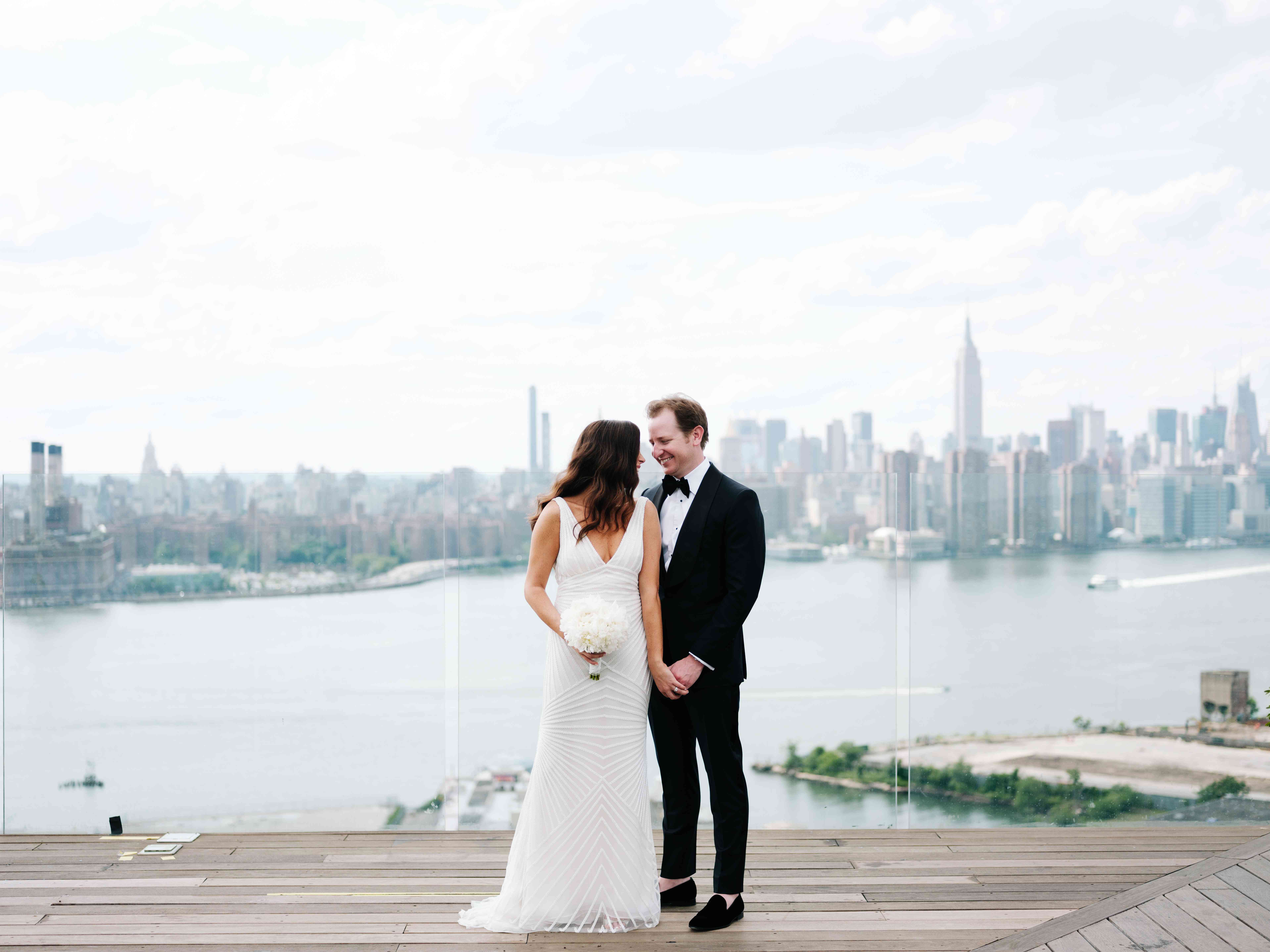 Couple posing with skyline behind them
