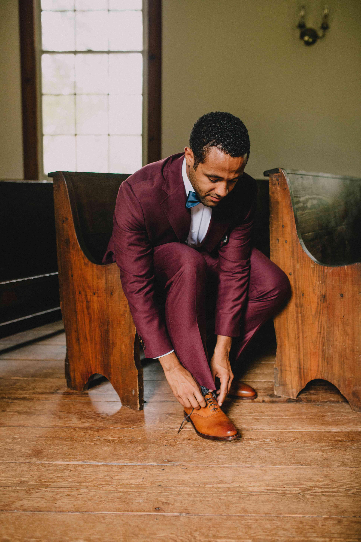 Groom in a maroon suit
