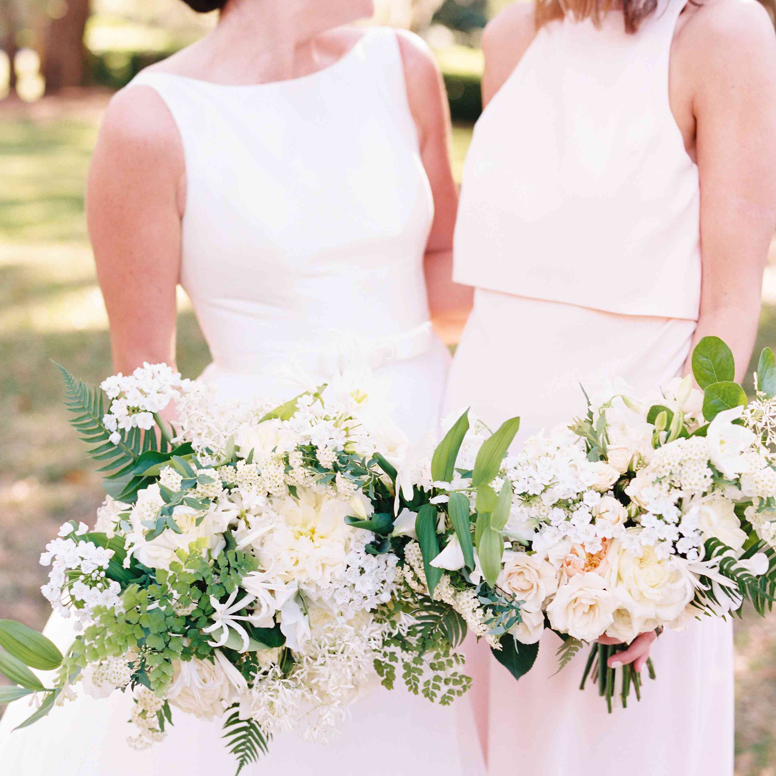 Bride laughing with bridesmaid friend