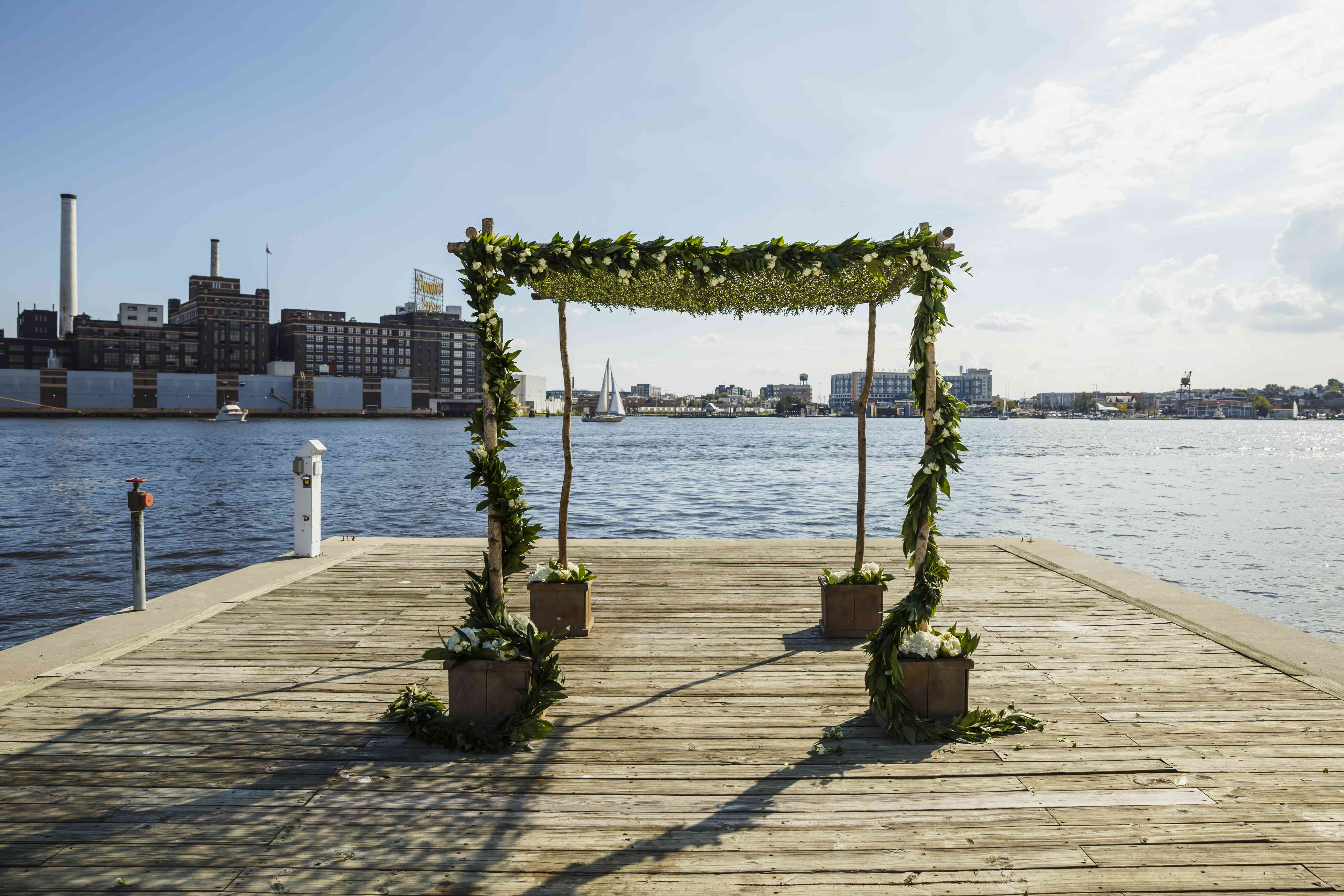 wooden chuppah at waterfront ceremony