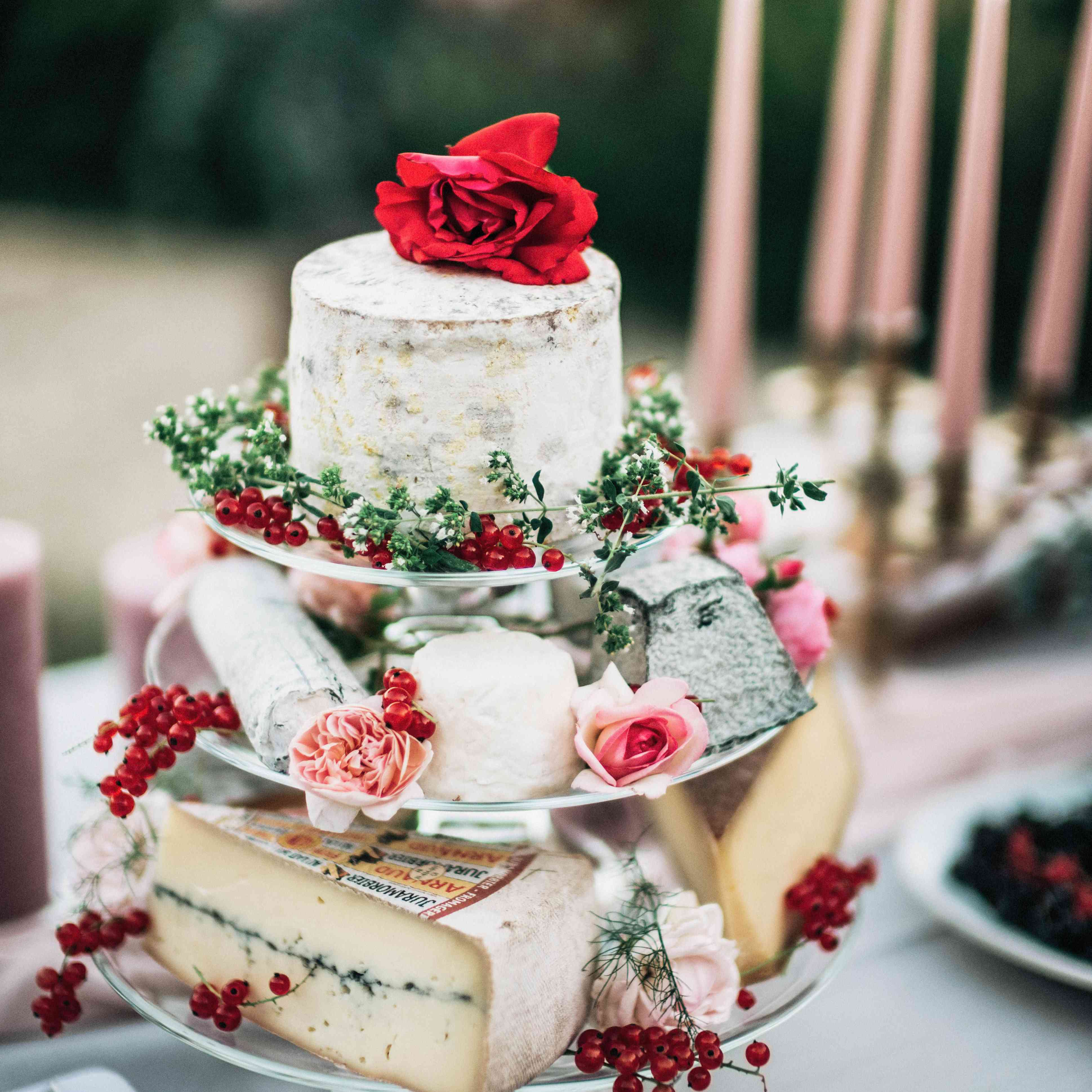 Cheese display with berries and flowers