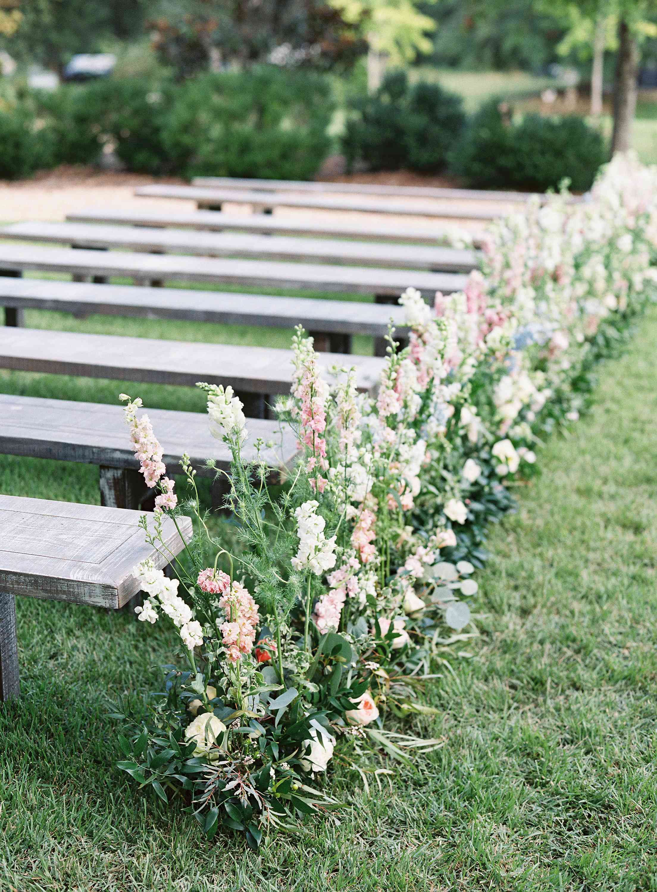Wedding aisle lined with flowers